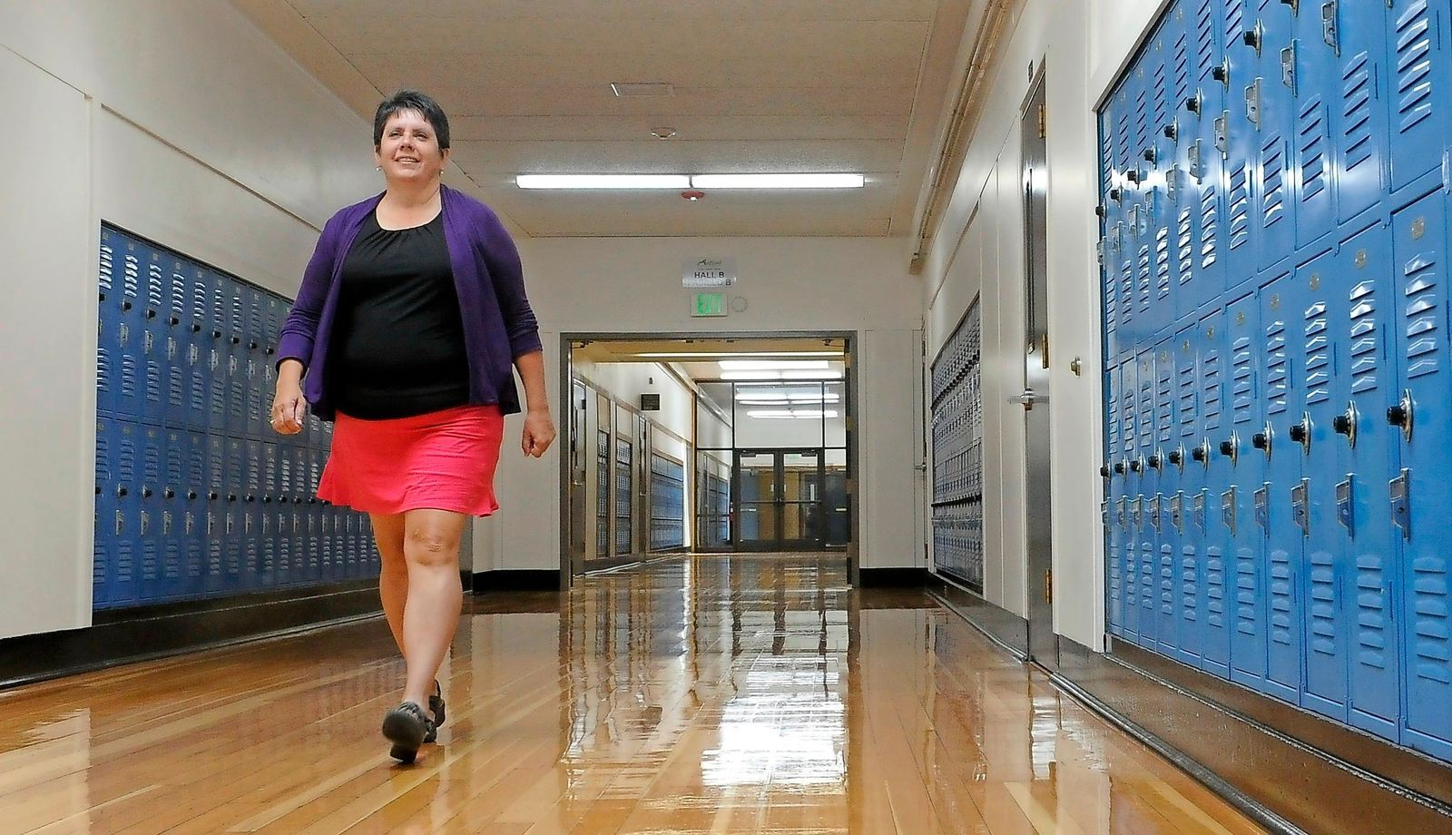 Amy Tiger walks through the hall way of Central High School and the Medford School District offices. (Andy Atkinson / Mail Tribune)