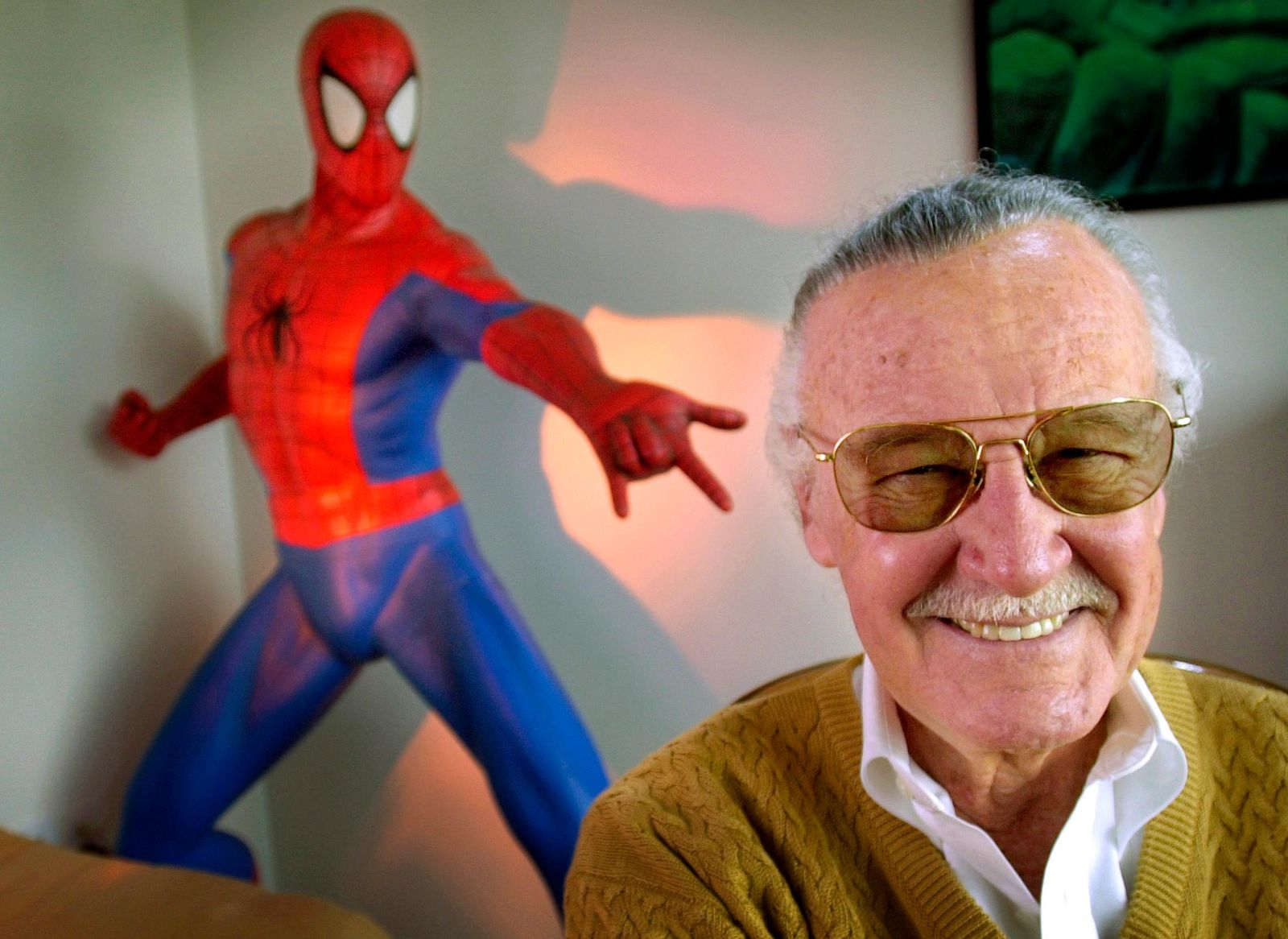"FILE - In this April 16, 2002, file photo, Stan Lee, 79, co-creator of comic-book franchises such as ""Spider-Man,"" ""The Incredible Hulk"" and ""X-Men,"" smiles during a photo session in his office in Santa Monica, Calif. (AP Photo/Reed Saxon, File)"