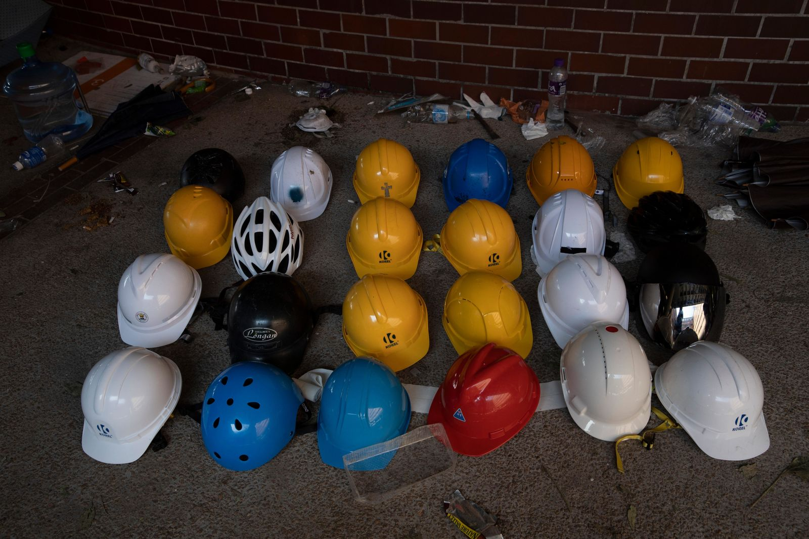 Helmets used by protesters are lined up at the Polytechnic University in Hong Kong on Wednesday, Nov. 20, 2019 (AP Photo/Ng Han Guan)