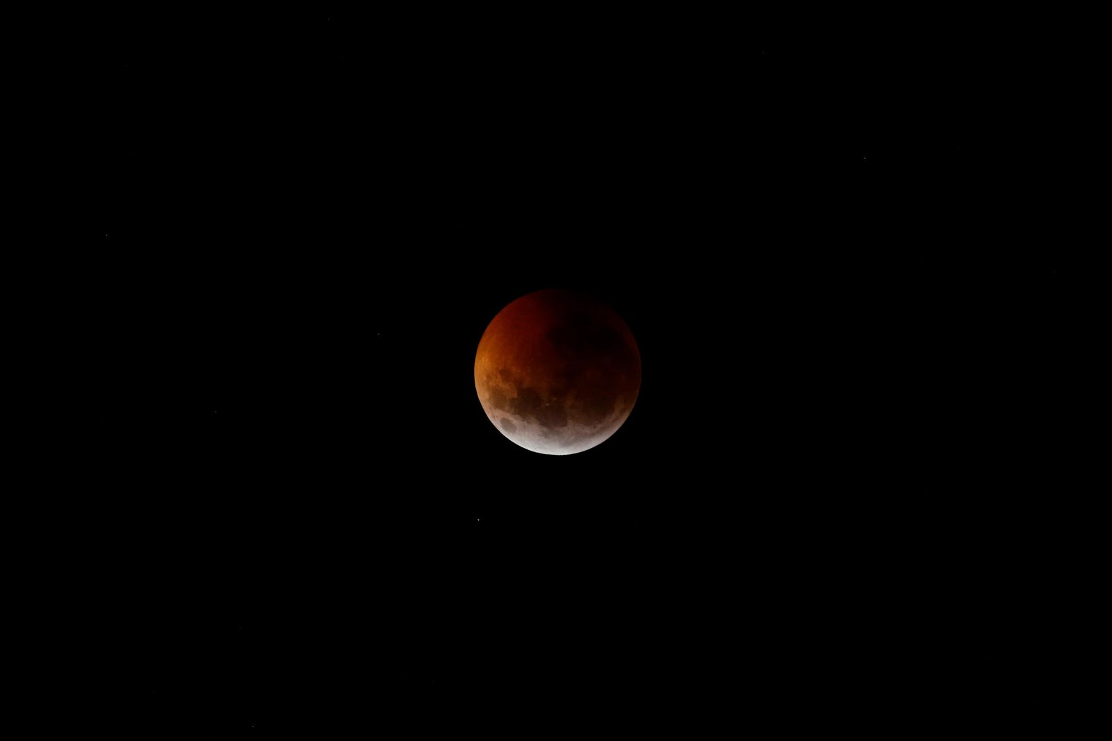 This photo shows the moon partially covered during a total lunar eclipse seen over Asuncion, Paraguay, Monday, Jan. 21, 2019. The entire eclipse will exceed three hours. Totality - when the moon's completely bathed in Earth's shadow - will last an hour. Expect the eclipsed, or blood moon, to turn red from sunlight scattering off Earth's atmosphere. (AP Photo/Jorge Saenz)
