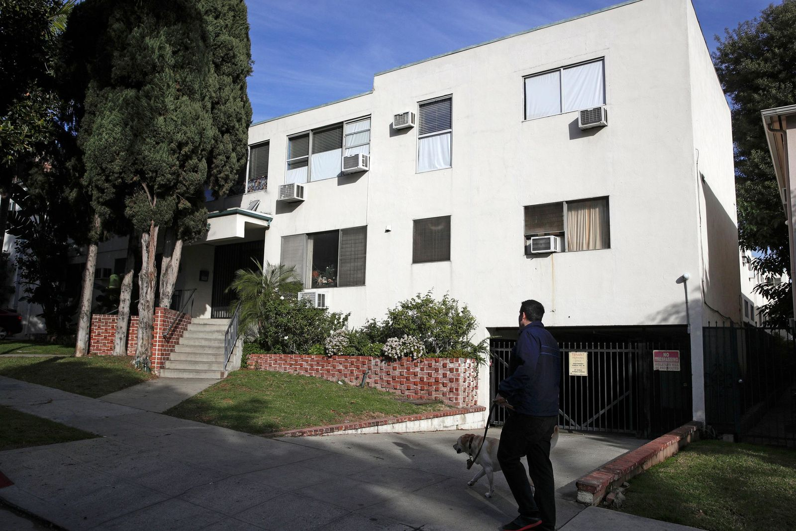 FILE - This Jan. 8, 2019 file photo shows the building housing the apartment of Ed Buck in West Hollywood, Calif., following the death of a man the previous day. (AP Photo/Jae C. Hong, File)