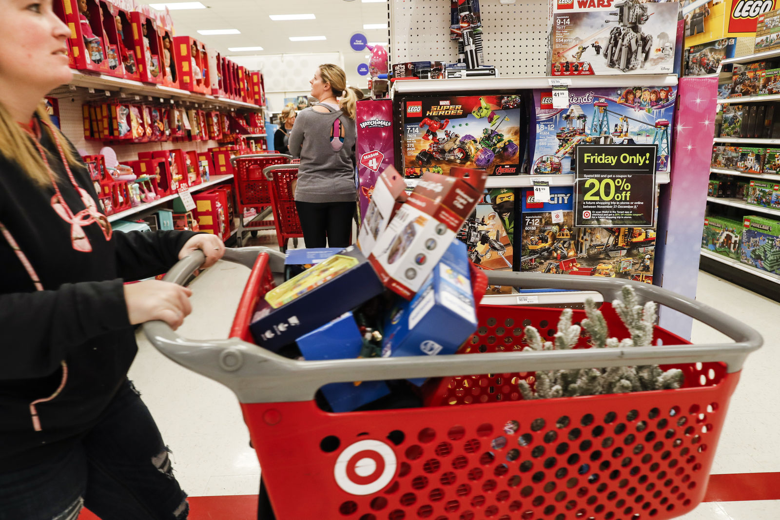{ }In this Nov. 23, 2018, file photo shoppers browse the aisles during a Black Friday sale at a Target store in Newport, Ky. Target on Thursday, Jan. 10, 2019, posted strong online growth in November and December.(AP Photo/John Minchillo, File)