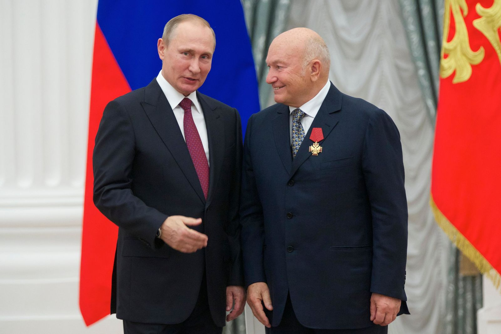 FILE - In this Thursday, Sept. 22, 2016 file photo, Russian President Vladimir Putin, left, presents a medal to former Moscow Mayor Yuri Luzhkov during an award ceremony in Moscow's Kremlin, Russia.{ } (AP Photo/Ivan Sekretarev, pool, FIle)
