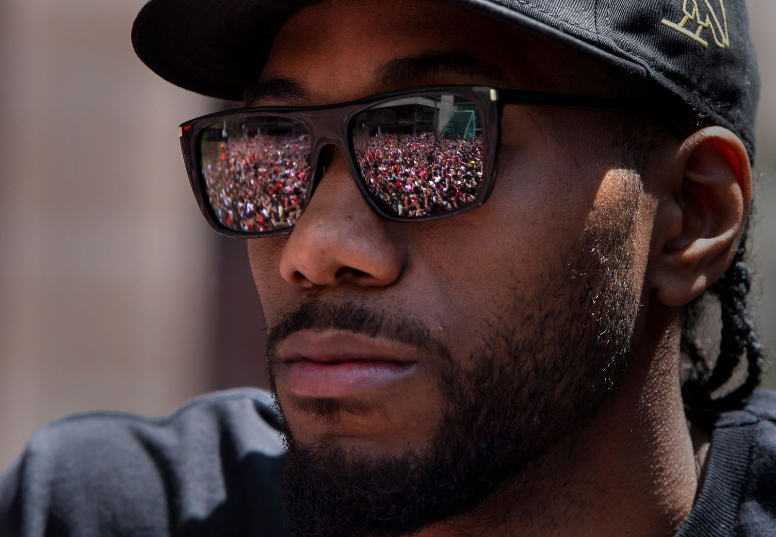Cheering fans are reflected in the sunglasses of Toronto Raptors' Kawhi Leonard during the team's NBA basketball championship parade in Toronto, Monday, June 17, 2019. (Frank Gunn/The Canadian Press via AP)