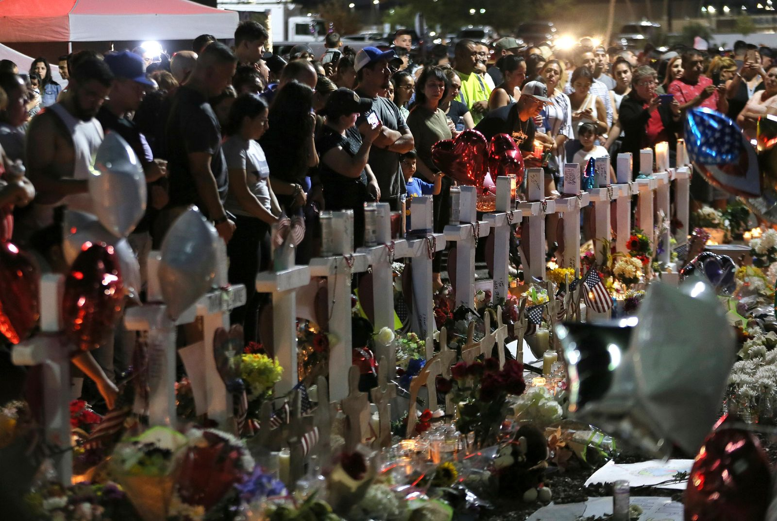 Hundreds of people hold vigil Monday, Aug. 5, 2019, outside the Walmart in El Paso, Texas, where a mass shooting took place on Saturday. (Mark Lambie/The El Paso Times via AP)