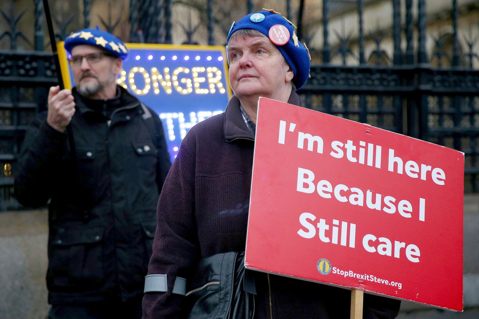 Anti-Brexit protestors stand outside the Houses of Parliament in London, Wednesday, Jan. 22, 2020. Britain are scheduled to leave the European Union on Jan. 31, 2020. (Hollie Adams via AP)