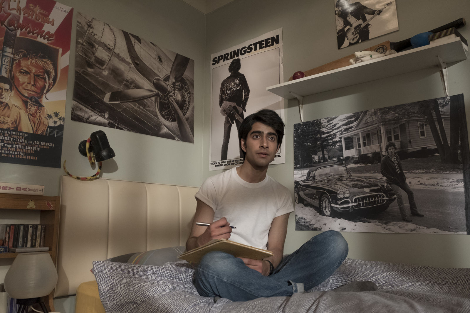 "This image provided by Warner Bros. Entertainment Inc. shows Viveik Kalra in a scene from ""Blinded by the Light,"" a Warner Bros. Pictures release in which Kalra plays Javed, a Pakistani-British teen whose life is transformed when a friend introduces him to Bruce Springsteen's music in 1987 Britain. (Nick Wall/Warner Bros. Entertainment Inc. via AP)"