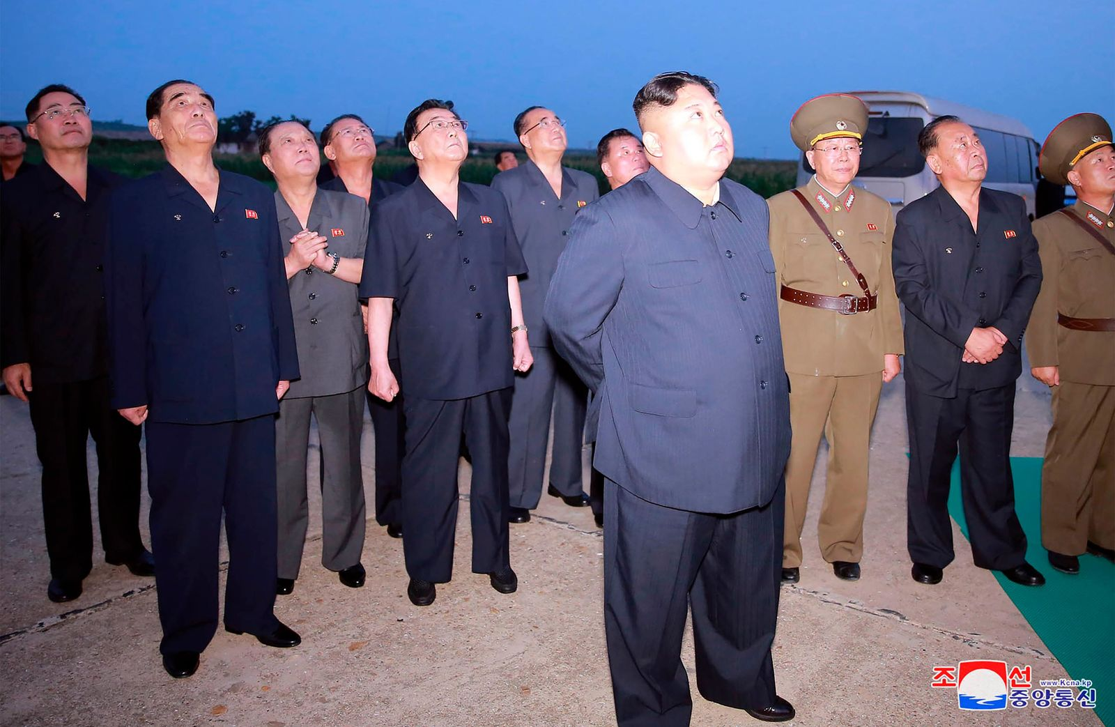 In this Tuesday, Aug. 6, 2019, photo provided by the North Korean government, North Korean leader Kim Jong Un, center, visits an airfield in the western area of North Korea to watch its weapons demonstrations.. (Korean Central News Agency/Korea News Service via AP)