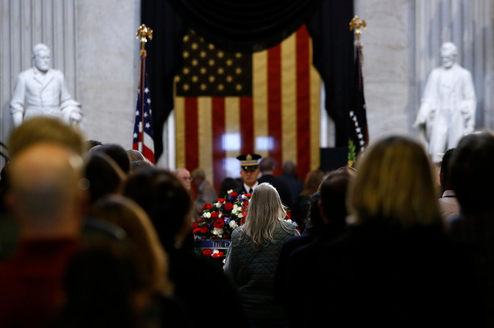 Visitors file into the Capitol Rotunda to view the flag-draped casket of former President George H.W. Bush as he lies in state in Washington, Tuesday, Dec. 4, 2018. (AP Photo/Patrick Semansky)