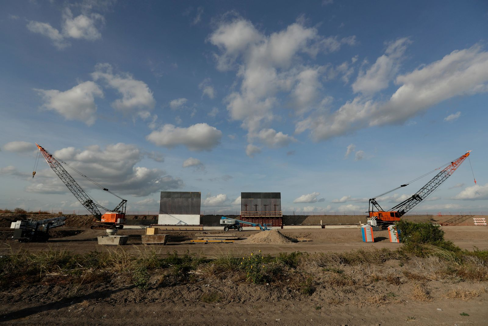 FILE - In this Nov. 7, 2019, file photo the first panels of levee border wall are seen at a construction site along the U.S.-Mexico border in Donna, Texas. A federal appeals court hears arguments against diverting Pentagon money for border wall construction as time runs out. It says the Trump administration has moved quickly to spend the money after the Supreme Court rejected an emergency appeal to prevent work from starting in July. (AP Photo/Eric Gay, File)