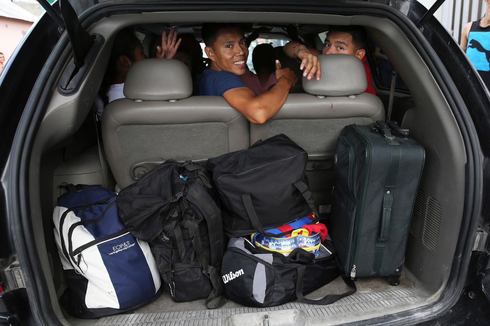 Migrants who where lodging at the AMAR migrant shelter get ready for a trip to the border in the Pastor's vehicle, to apply for asylum in the United States side, from Nuevo Laredo, Mexico, Wednesday, July 17, 2019. Asylum-seekers grappled to understand what a new U.S. policy that all but eliminates refugee claims by Central Americans and many others meant for their bids to find a better life in America amid a chaos of rumors, confusion and fear. (AP Photo/Marco Ugarte)