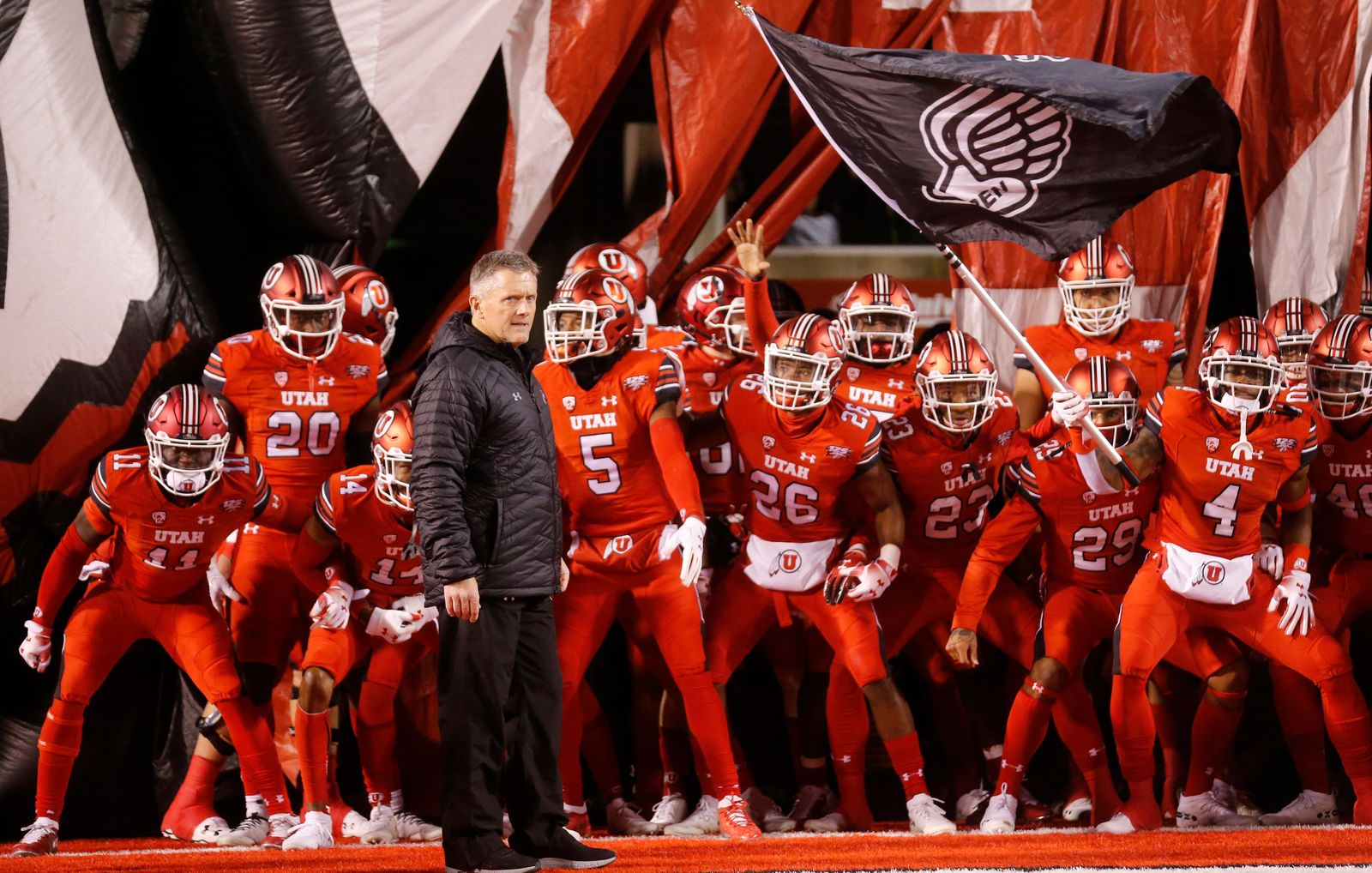 FILE - In this Nov. 24, 2018, file photo, Utah head coach Kyle Whittingham and his team prepares to take the field prior to their game against the BYU during an NCAA college football game, in Salt Lake City. The Utes were selected to win the Pac-12 in the preseason media poll and they're also ranked in the preseason coaches' poll. (AP Photo/Rick Bowmer, File)