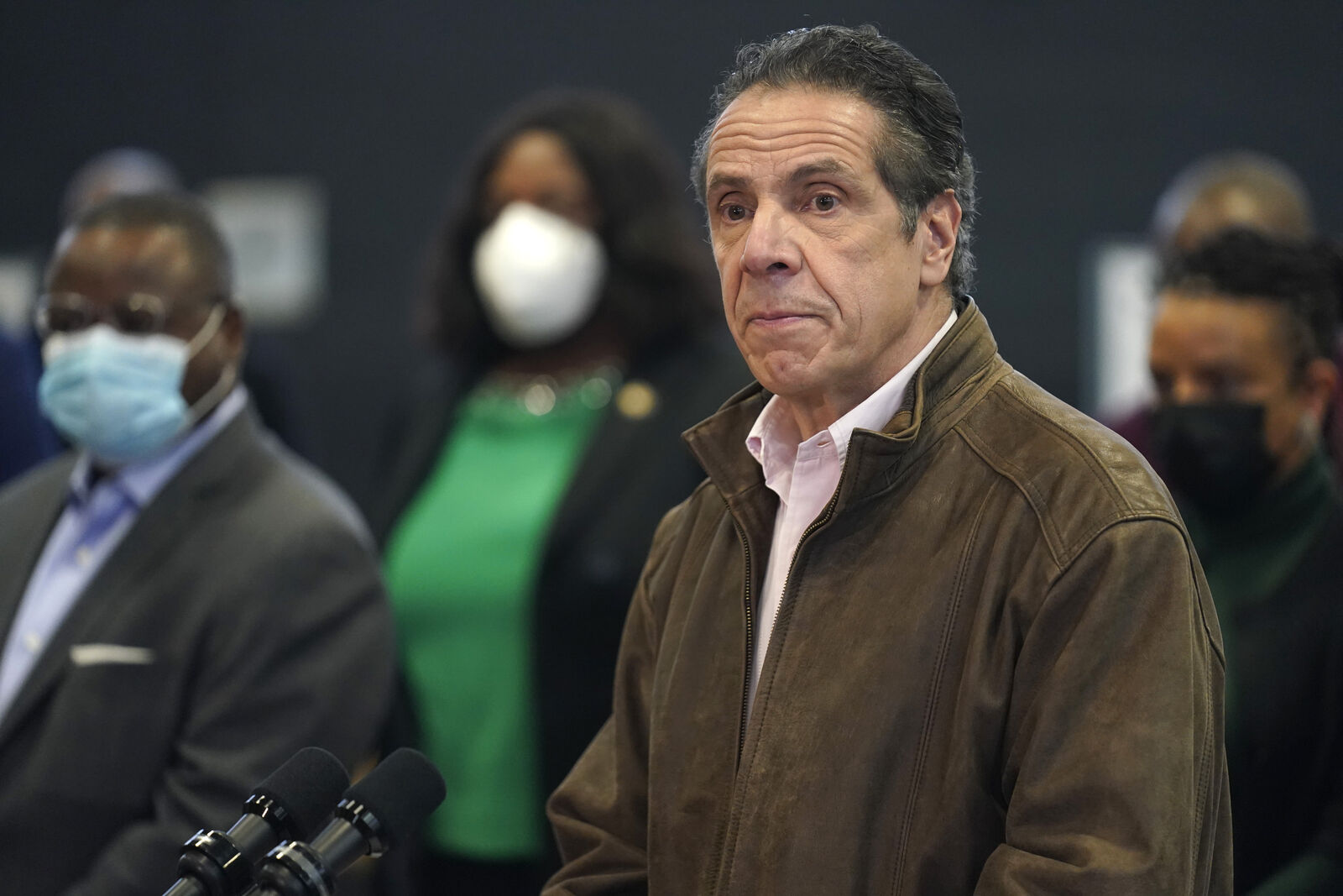 FILE - In this Feb. 22, 2021 photo, New York Gov. Andrew Cuomo, right, pauses to listen to a reporter's question during a news conference at a COVID-19 vaccination site in the Brooklyn borough of New York. (AP Photo/Seth Wenig, Pool, file)