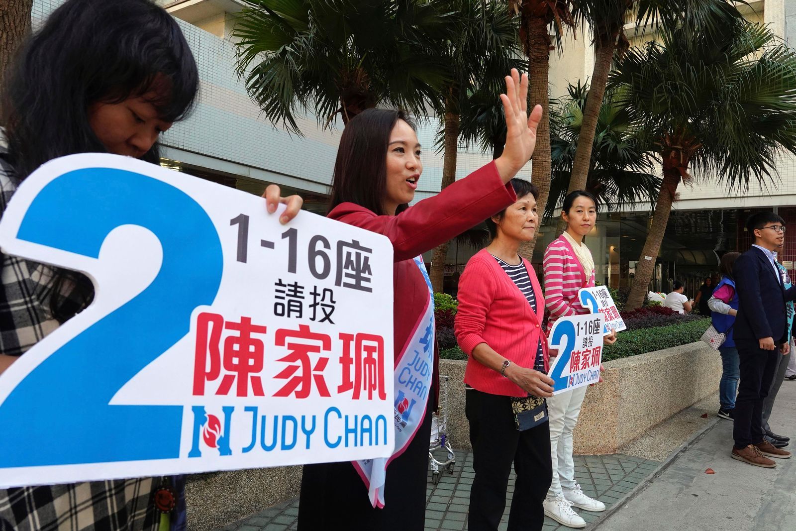 "Pro-government candidate Judy Chan, second from left, campaigns ahead of local elections in Hong Kong, Saturday, Nov. 23, 2019. Chanting ""No more tear gas,"" dozens of Hong Kong families with young children are marching to oppose the government's handling of protests on the eve of keenly contested local elections. (AP Photo/Vincent Yu)"