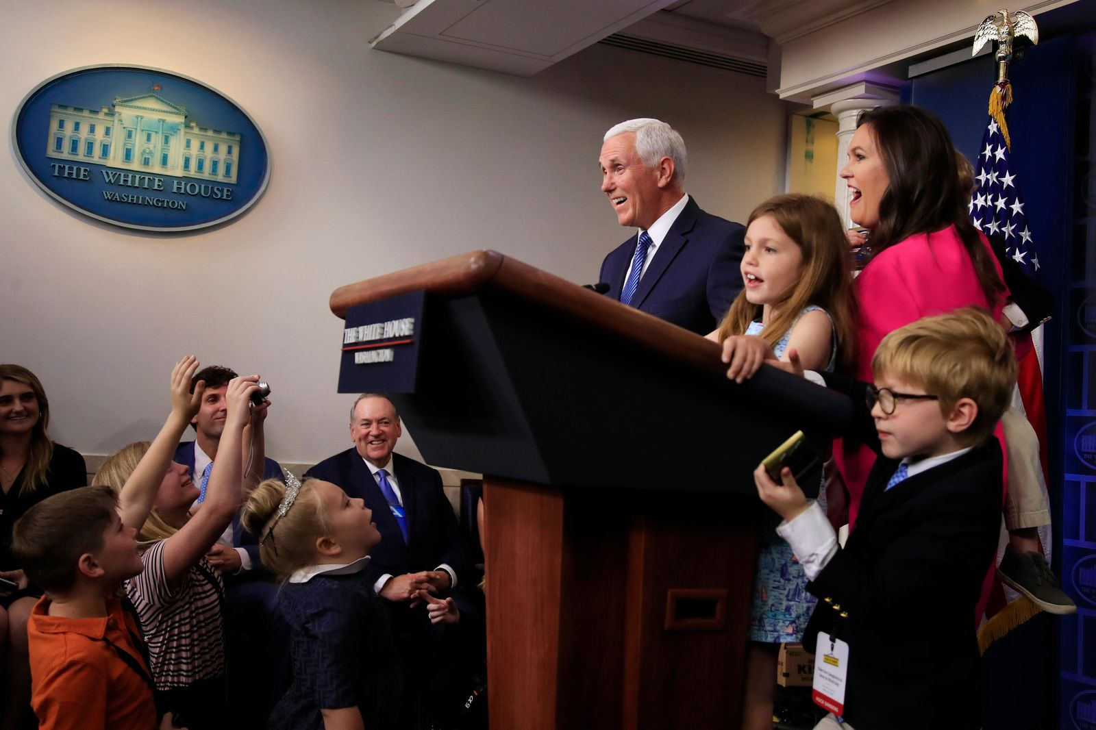 Vice President Mike Pence makes a surprise appearance as White House press secretary Sarah Huckabee Sanders conducts a briefing for children of journalists and White House staff in the Brady press briefing room at the White House in Washington, Thursday, April 25, 2019, to commemorate Take Our Daughters and Sons to Work Day. (AP Photo/Manuel Balce Ceneta)