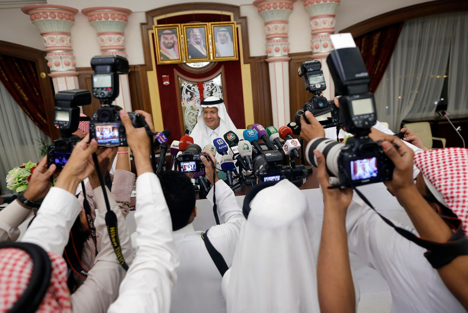 Saudi Energy Minister Prince Abdulaziz bin Salman, is surrounded by photographers as he enters a press conference in Jiddah, Saudi Arabia, Tuesday, Sept. 17, 2019. (AP Photo/Amr Nabil)