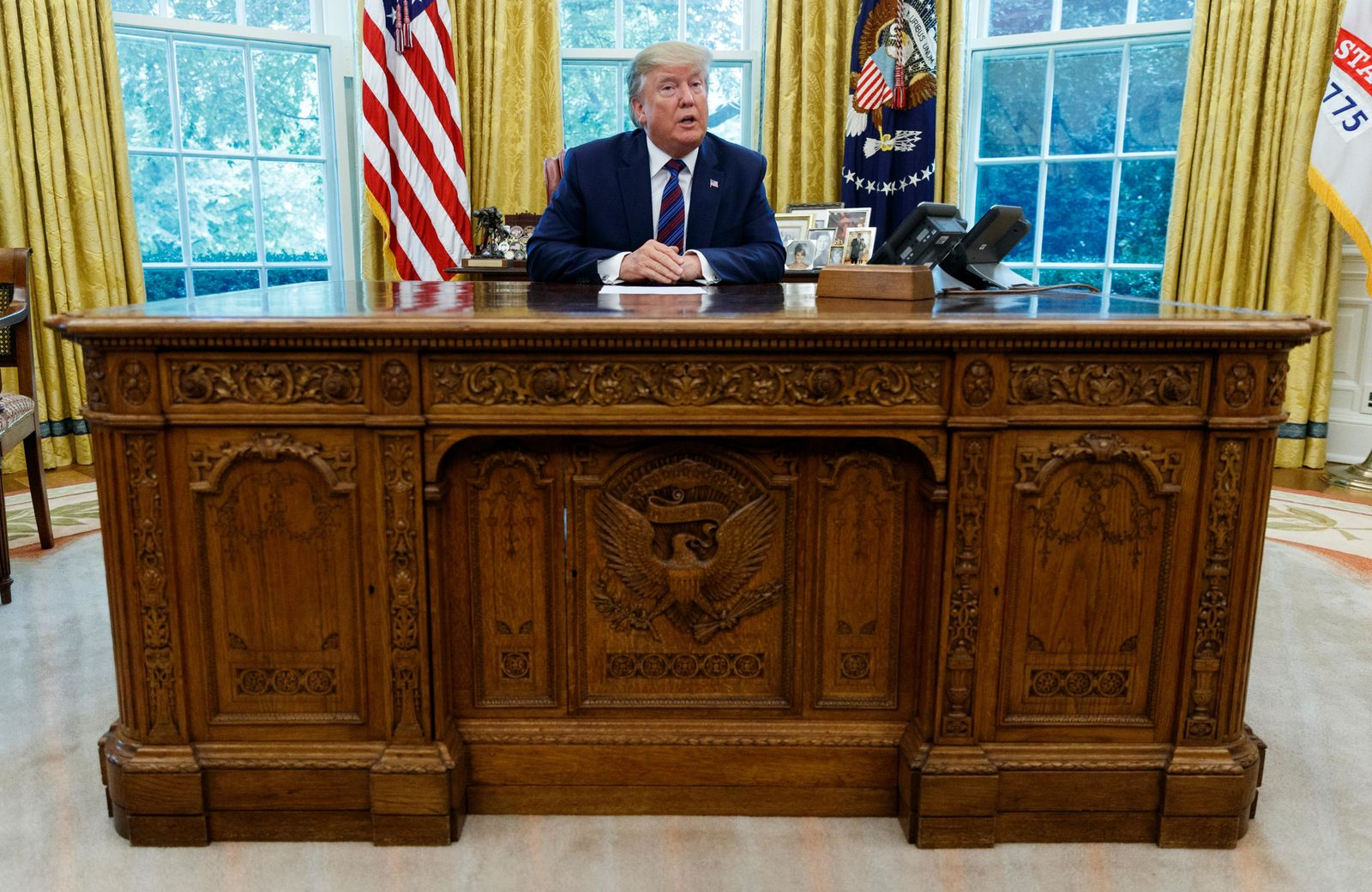 President Donald Trump speaks in the Oval Office of the White House in Washington, Friday, July 26, 2019. Trump announced that Guatemala is signing an agreement to restrict asylum applications to the U.S. from Central America. (AP Photo/Carolyn Kaster)