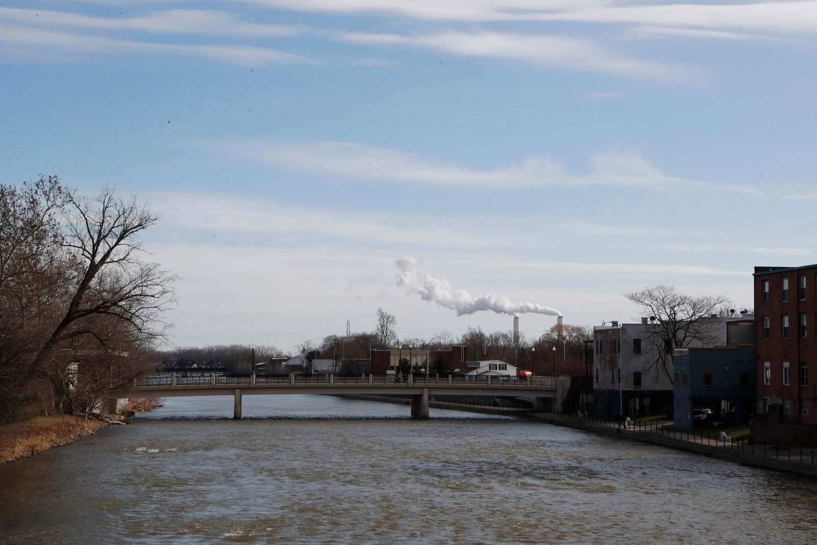 This Tuesday, Jan. 7, 2020 photo shows the River Raisin flowing east through Monroe, Mich. Monroe County, population 150,000, has suffered six military casualties since 2001, putting it above the national per capita averages.  (AP Photo/Carlos Osorio)
