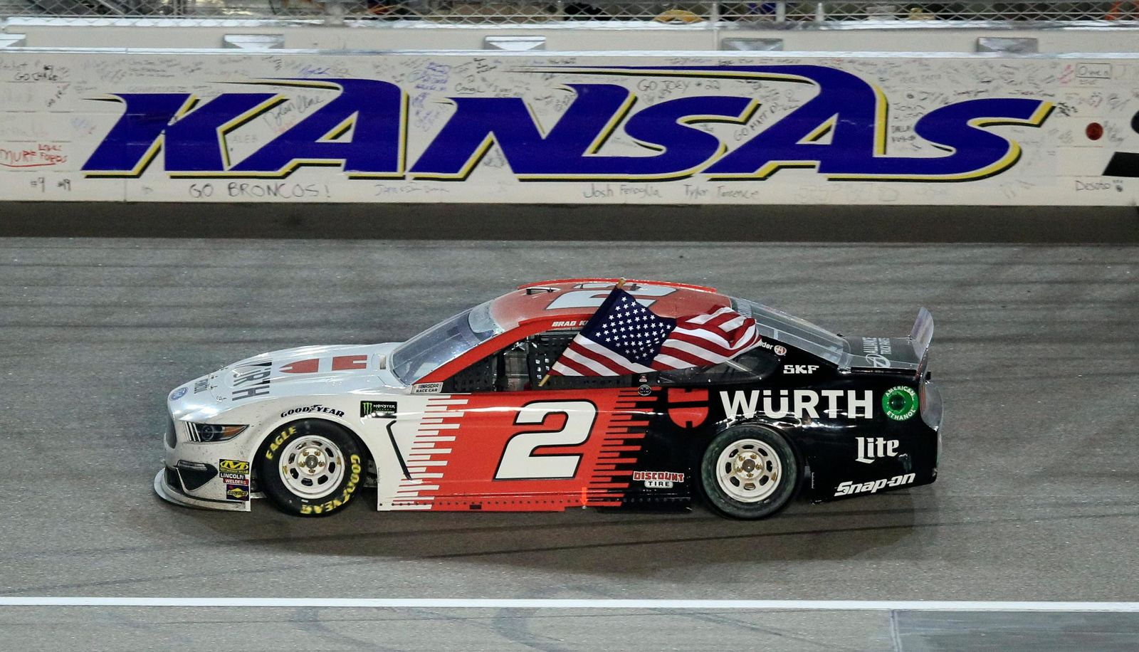 Brad Keselowski (2) celebrates after winning the NASCAR Cup Series auto race at Kansas Speedway in Kansas City, Kan., Saturday, May 11, 2019. (AP Photo/Orlin Wagner)