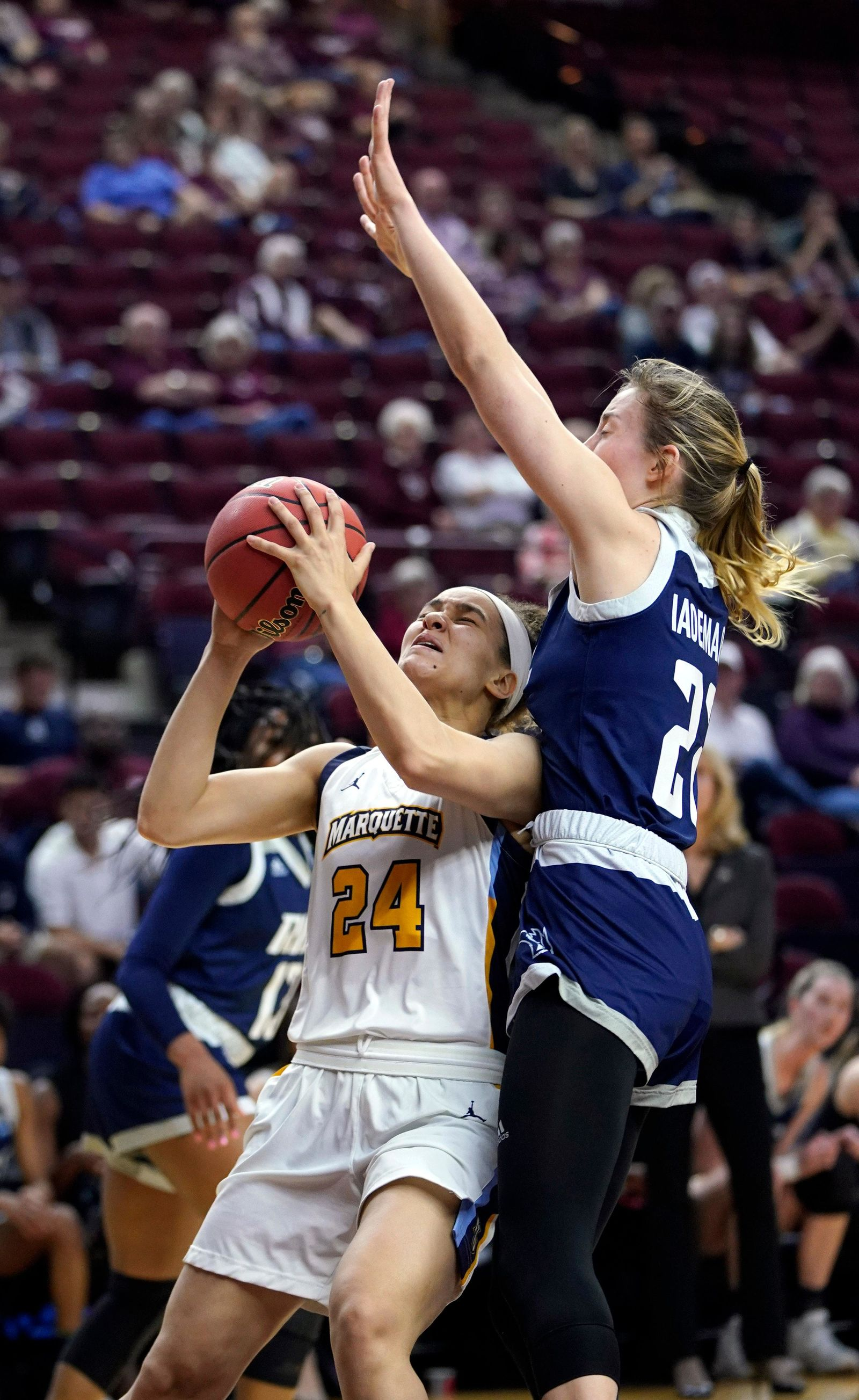 Marquette's Selena Lott (24) shoots as Rice's Nicole Iademarco (22) defends during the first half of a first round women's college basketball game in the NCAA Tournament Friday, March 22, 2019, in College Station, Texas. (AP Photo/David J. Phillip)