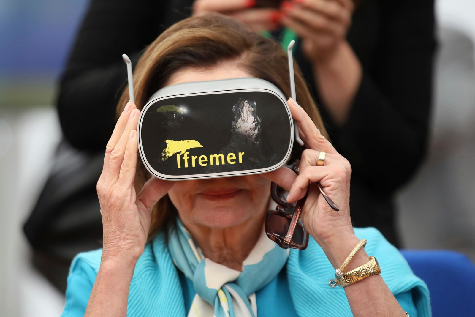 U.S. House Speaker Nancy Pelosi wears a virtual reality mask as she visits the French Research Institute for the Exploitation of the Sea (IFREMER), in Brest, western France, Friday, Sept. 6, 2019. (AP Photo/David Vincent, Pool)