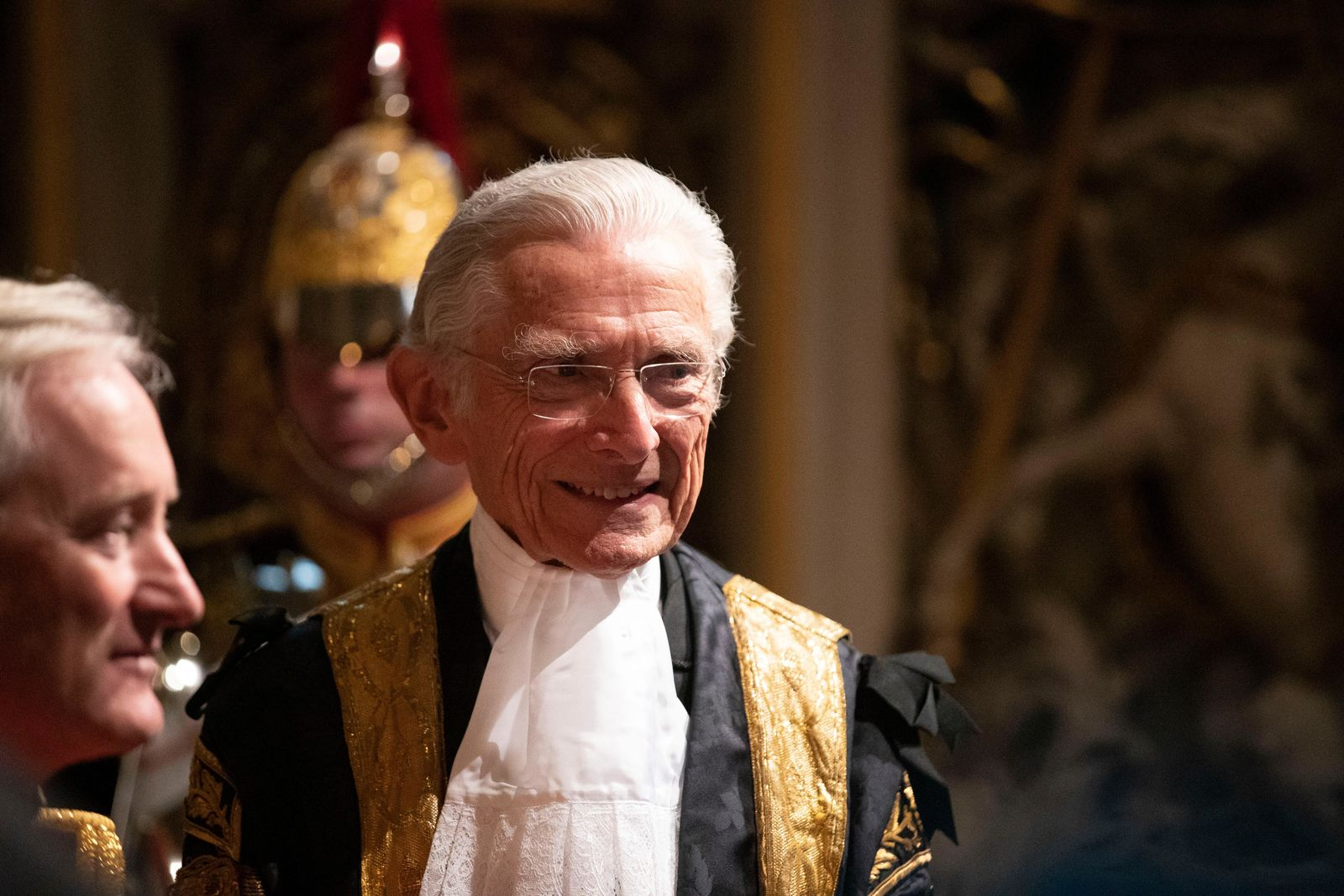 Lord Speaker Norman Fowler speaks to dignitaries in the Norman Porch at the Palace of Westminster and the Houses of Parliament at the State Opening of Parliament ceremony in London, Monday, Oct. 14, 2019. (AP Photo/Matt Dunham, Pool)