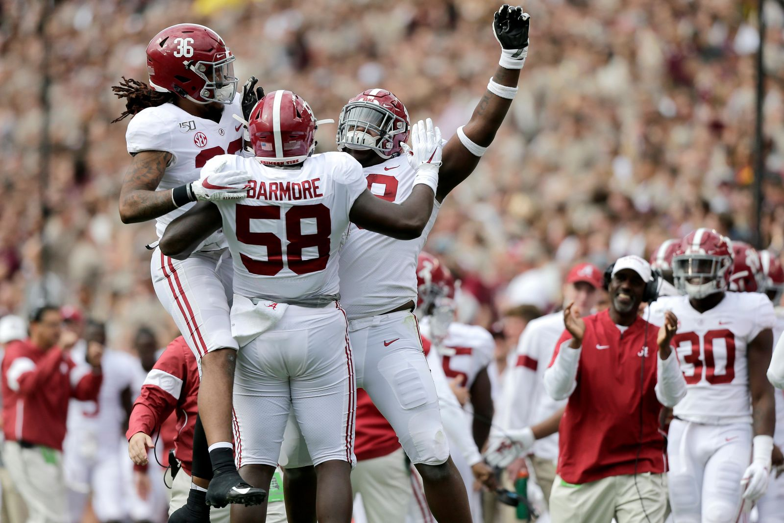 Alabama defensive lineman Christian Barmore (58) celebrates with teammates after sacking Texas A&M quarterback Kellen Mond (11) during the first half of an NCAA college football game, Saturday, Oct. 12, 2019, in College Station, Texas. (AP Photo/Sam Craft)
