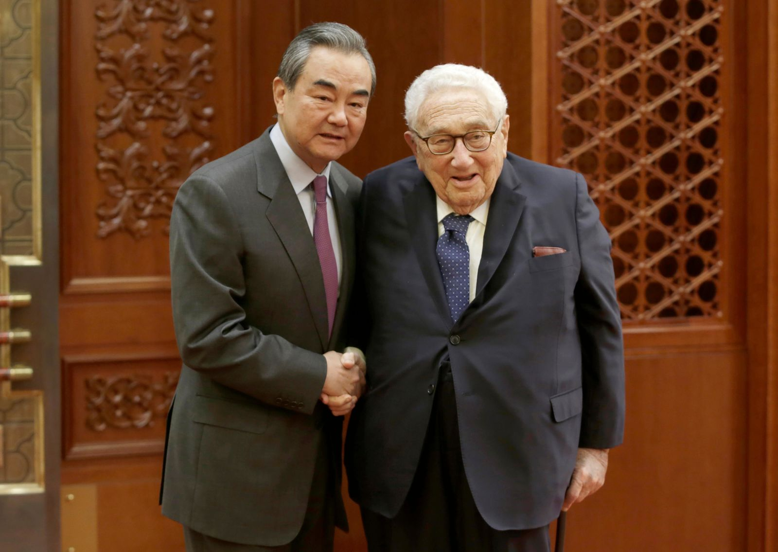 Chinese Foreign Minister Wang Yi meets former U.S. Secretary of State Henry Kissinger at the Great Hall of the People in Beijing, Friday, Nov. 22, 2019. (Jason Lee/Pool Photo via AP)