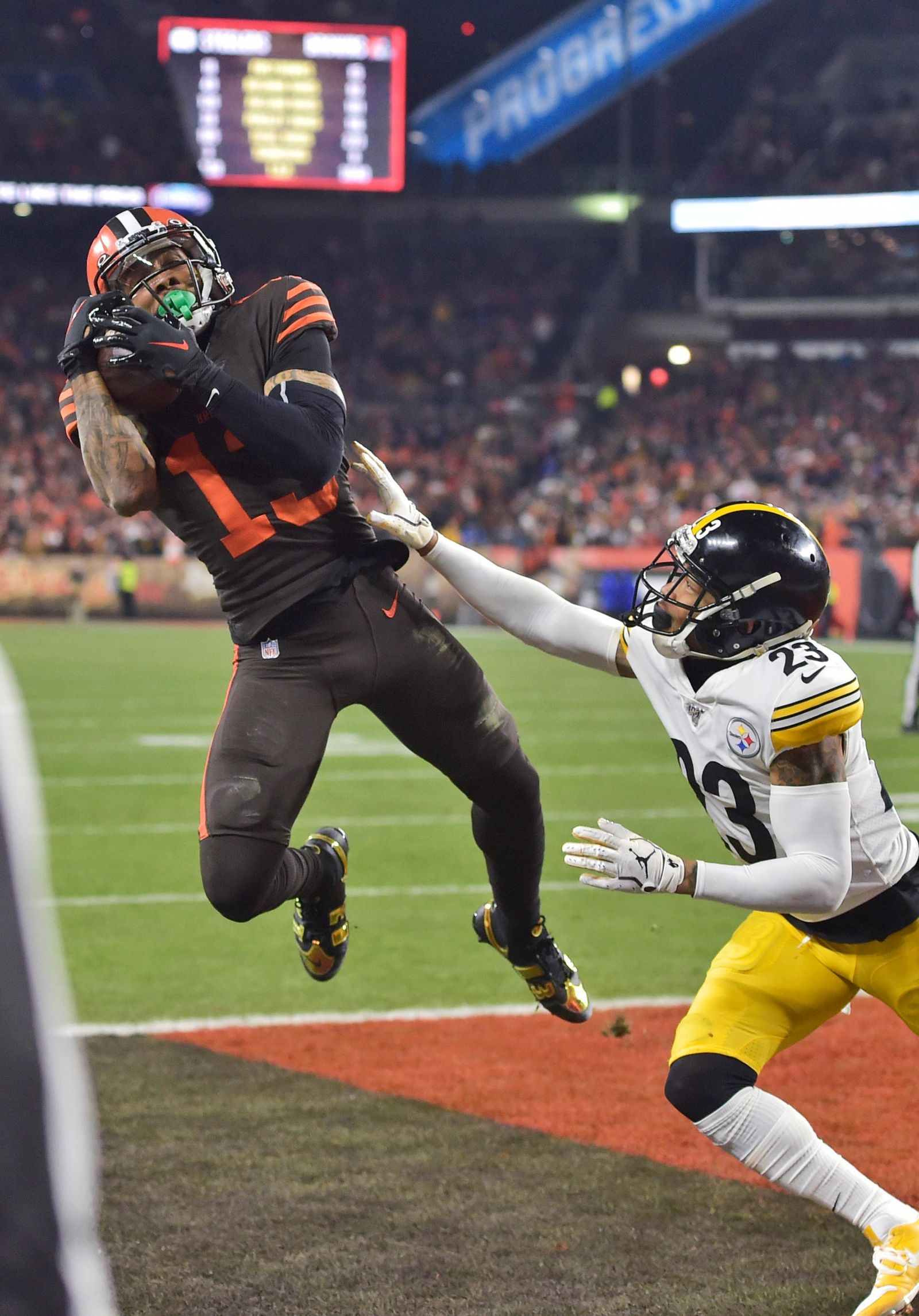 Cleveland Browns wide receiver Odell Beckham Jr., left, can't hold on to the ball under pressure from Pittsburgh Steelers cornerback Joe Haden during the second half of an NFL football game Thursday, Nov. 14, 2019, in Cleveland. (AP Photo/David Richard)