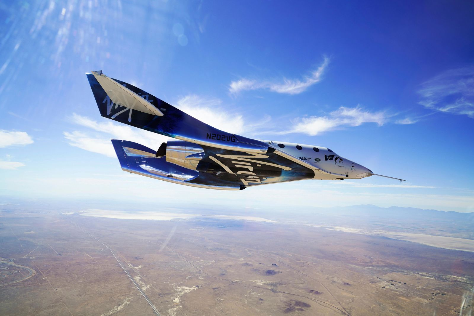 FILE - In this May 29, 2018 photo provided by Virgin Galactic, the VSS Unity craft flies during a supersonic flight test. Virgin Galactic has received nearly 8,000 online reservations of interest since its first successful test flight into space 14 months ago, the company said Tuesday, Feb. 25, 2020, as it nears commercial operation and prepares to reopen ticket sales. (Virgin Galactic via AP, File)