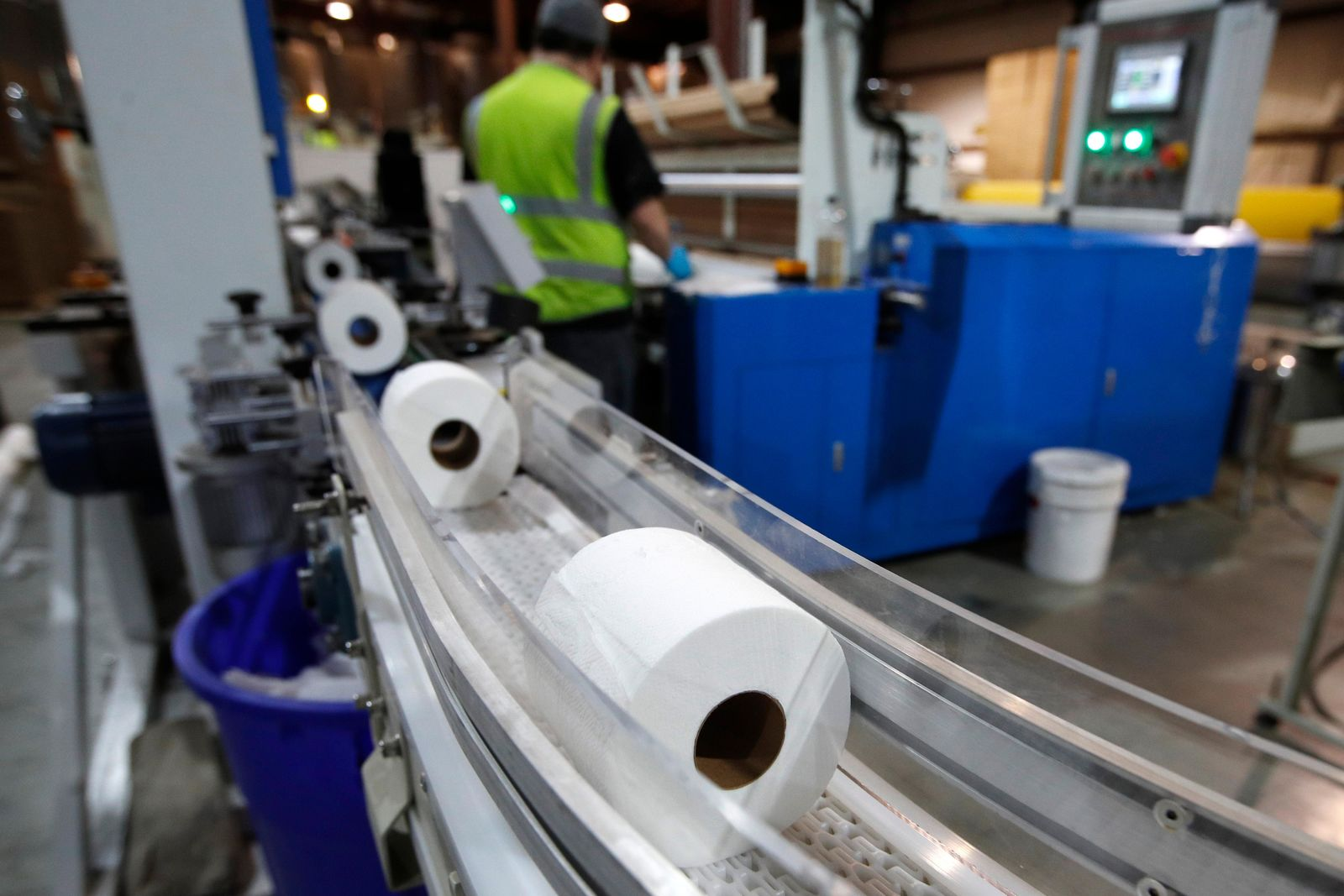Toilet paper moves out from a cutting machine at the Tissue Plus factory, Wednesday, March 18, 2020, in Bangor, Maine. The new company has been unexpectedly busy because of the shortage of toilet paper brought on by hoarders concerned about the coronavirus. (AP Photo/Robert F. Bukaty)