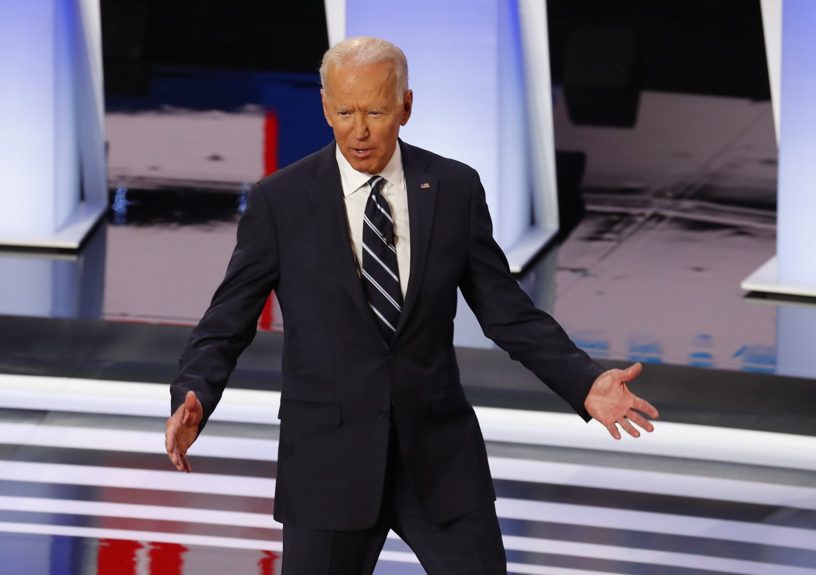 Former Vice President Joe Biden is introduced before the second of two Democratic presidential primary debates hosted by CNN Wednesday, July 31, 2019, in the Fox Theatre in Detroit. (AP Photo/Paul Sancya)
