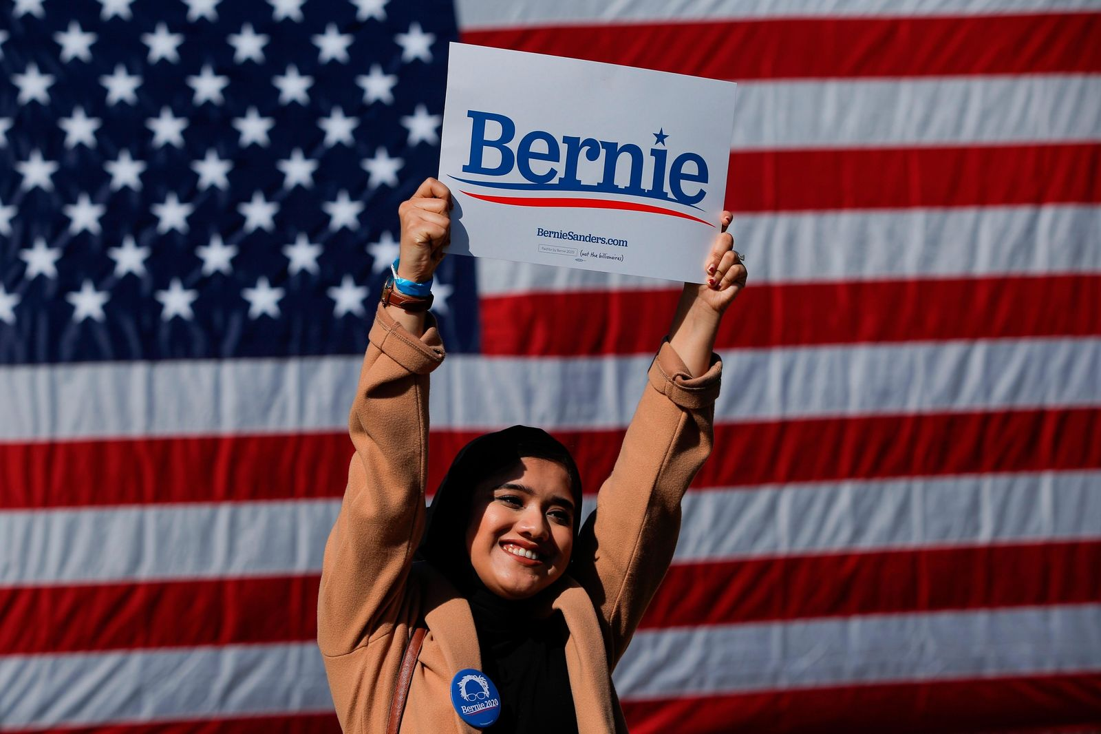 A woman attends a rally for Democratic presidential candidate Sen. Bernie Sanders, I-Vt., on Saturday, Oct. 19, 2019 in New York. (AP Photo/Eduardo Munoz Alvarez)