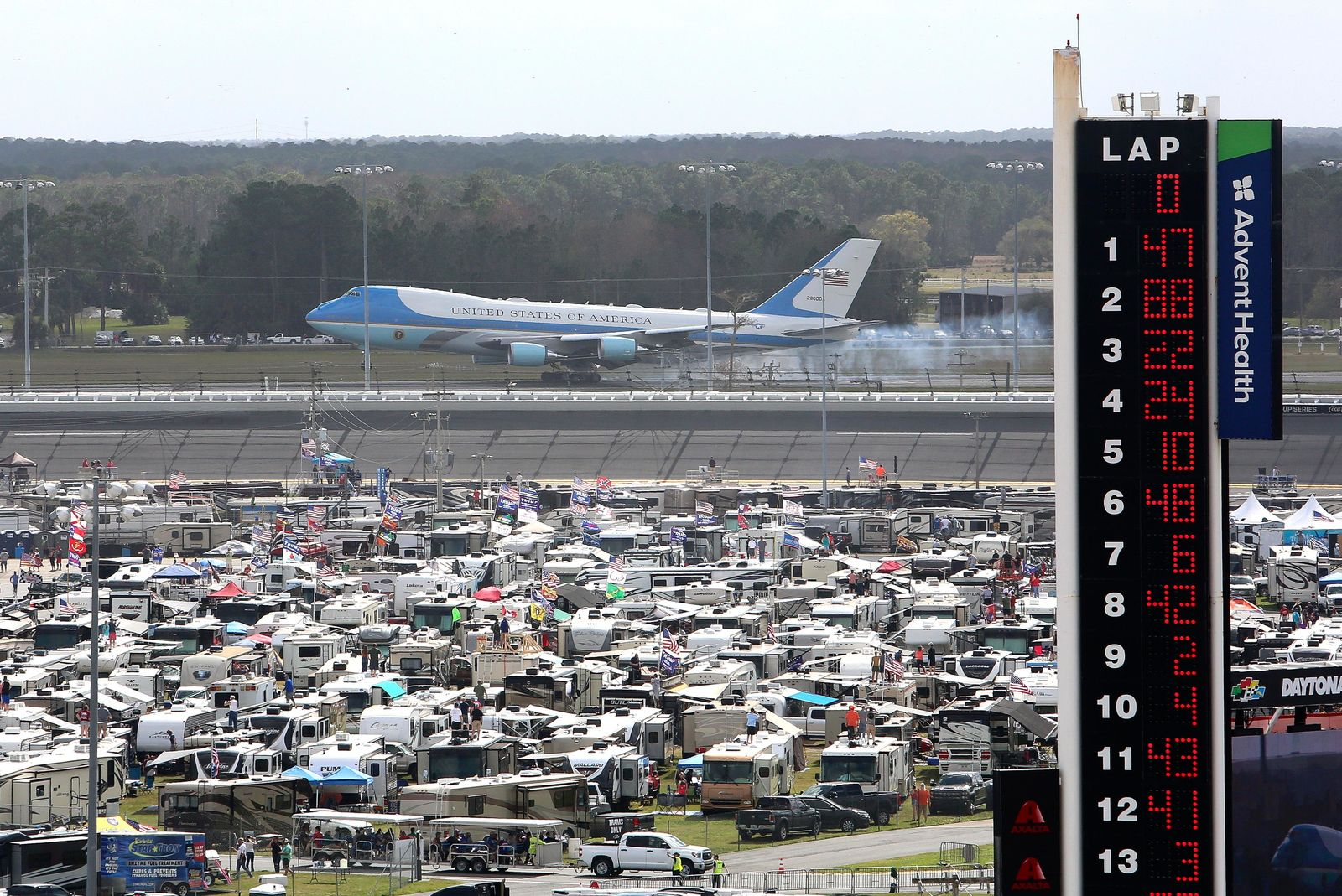 Air Force One touches down at the Daytona Beach International's Airport as seen from Daytona International Speedway as President Donald Trump makes his arrival to attend the NASCAR Daytona 500 auto race, Sunday, Feb. 16, 2020, in Daytona Beach, Fla. (AP Photo/David Graham)