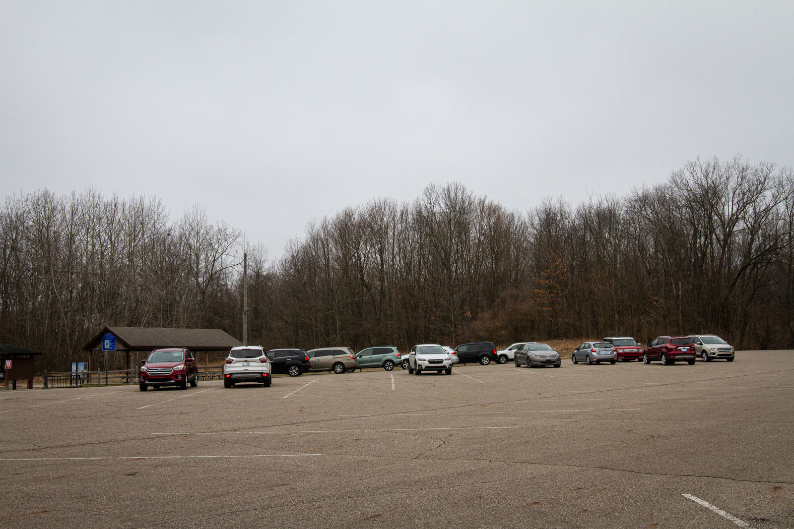 Cars line the parking lot of Kal-Haven State Park on Wednesday, March 25.{ }(WWMT/Sarah White)