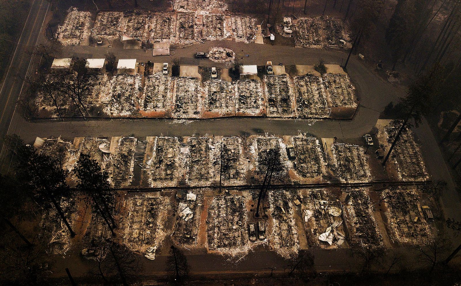 FILE - This Nov. 15, 2018, file photo, shows the remains of residences leveled by a wildfire in Paradise, Calif.{ } (AP Photo/Noah Berger, File)