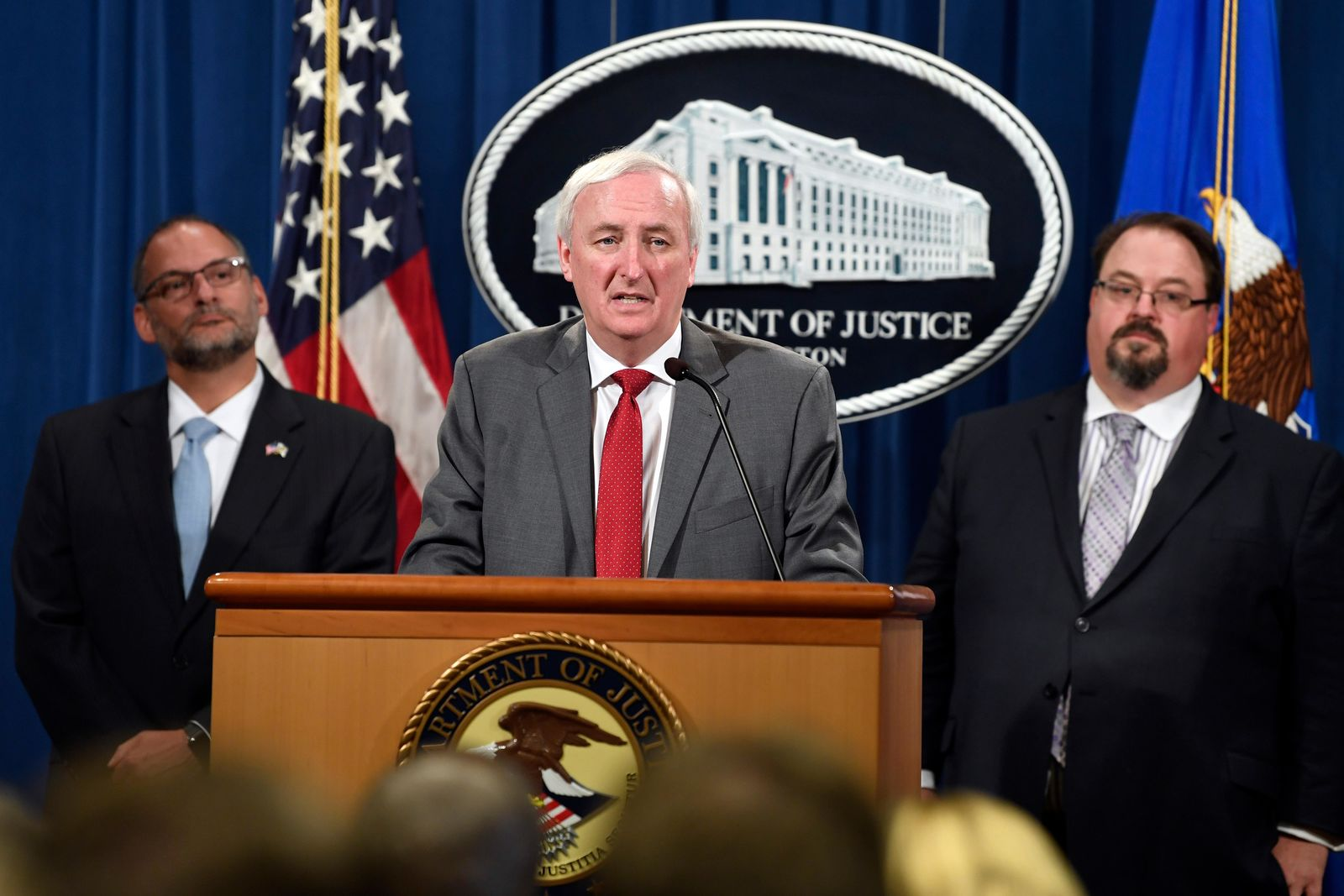 Deputy Attorney General Jeffrey Rosen, center, flanked by Hugh Hurwitz, left, the acting director of the Bureau of Prisons, and David Muhlhausen, director of the National Institute of Justice, speaks during a news conference at the Justice Department in Washington, Friday, July 19, 2019, on developments in the implementation of the First Step Act. . (AP Photo/Susan Walsh)