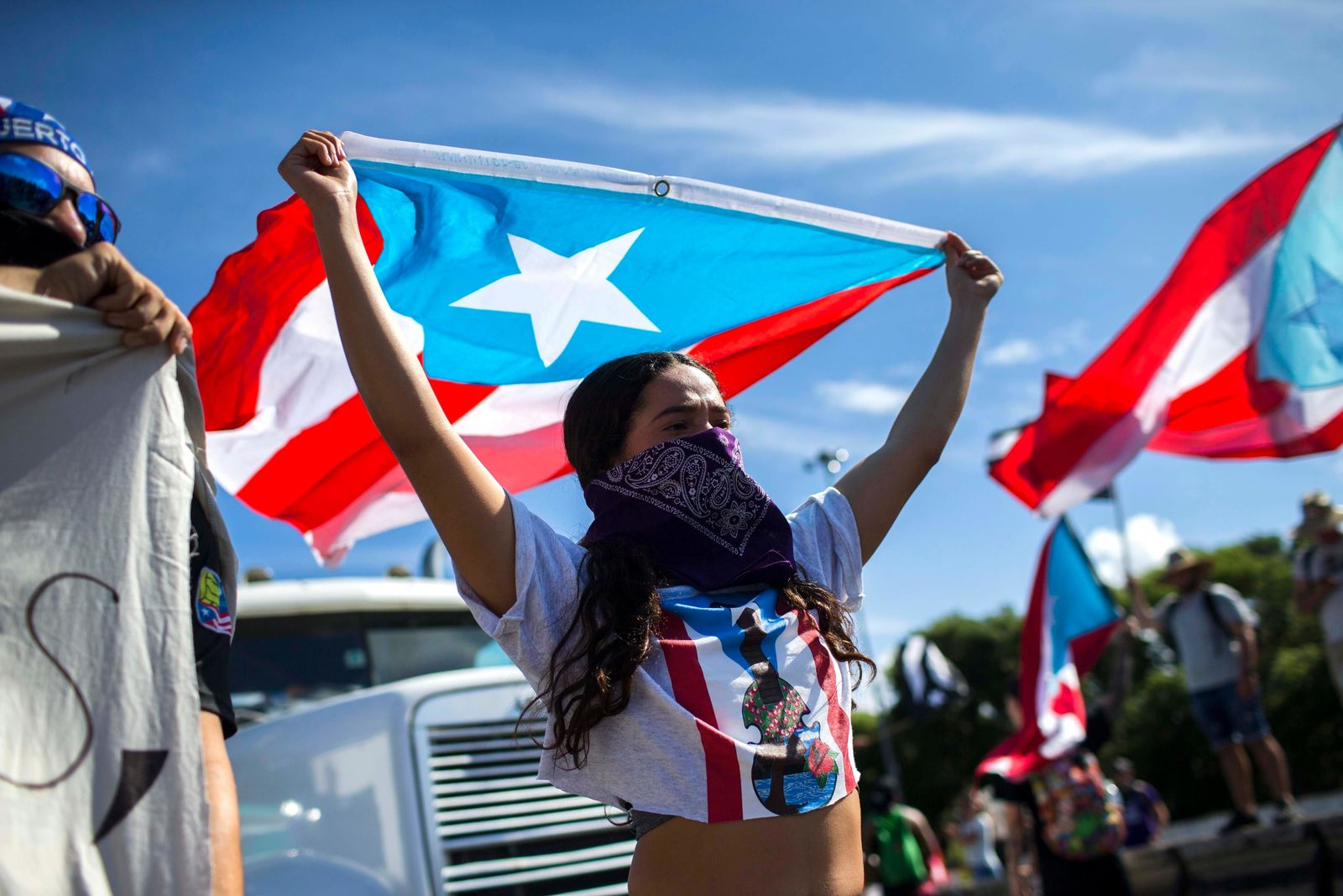 Demonstrators join a protest to demand the resignation of Governor Ricardo Rossello from office, in San Juan, Puerto Rico, Monday, July 22, 2019.{ } (AP Photo/Dennis M. Rivera Pichardo)