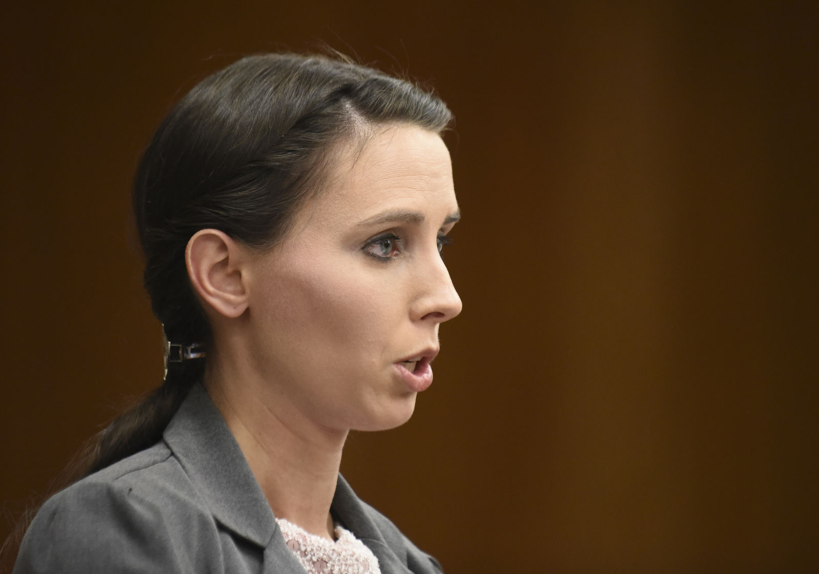 FILE - In this Feb. 2, 2018, file photo, Rachael Denhollander speaks during her victim impact statement, in Eaton County Circuit Court in Judge Janet Cunningham's courtroom in Charlotte, Mich. Denhollander, the first woman who publicly accused convicted sports doctor Larry Nassar of sexual abuse says she is horrified and deeply disappointed with the University of Michigan for how it has handled allegations of abuse by Dr. Robert E. Anderson, at the school. The former gymnast said on Saturday, Feb. 22, 2020, that the school chose corruption over transparency when they put the survivors in a place where they had no choice but to speak publicly. (Matthew Dae Smith/Lansing State Journal via AP, File)