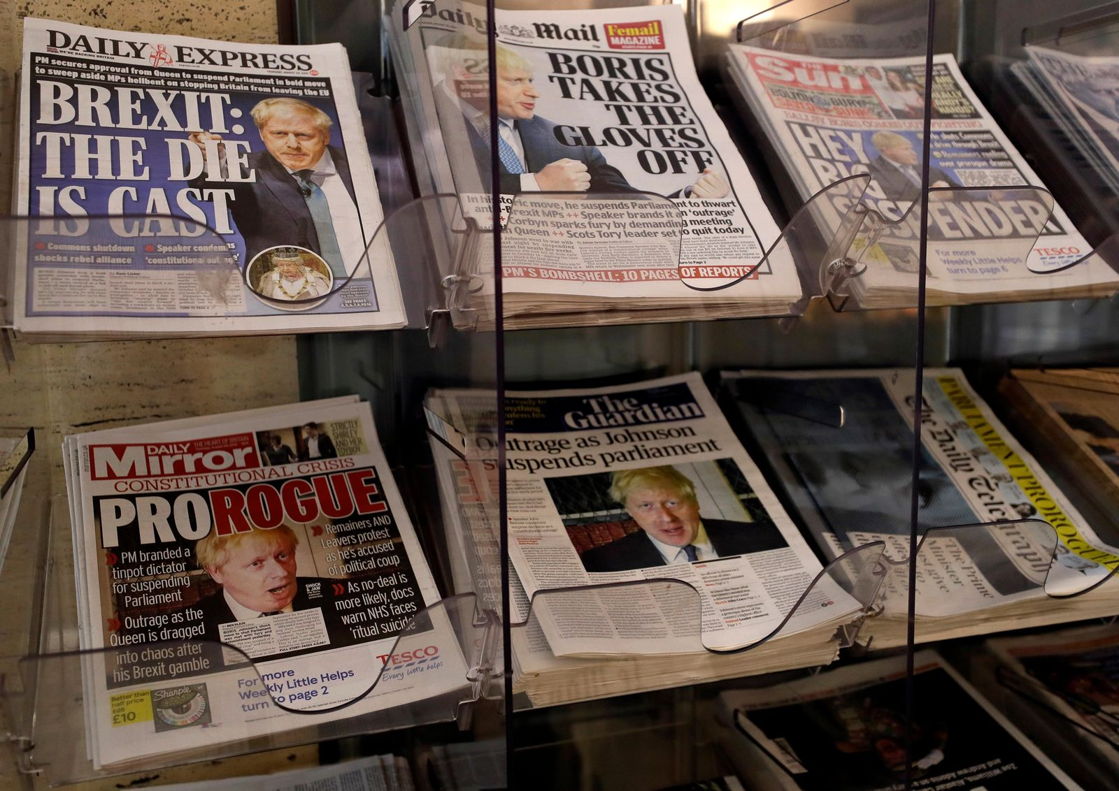 British Newspapers are seen for sale on a rack in London, Thursday, Aug. 29, 2019.{ } (AP Photo/Kirsty Wigglesworth)