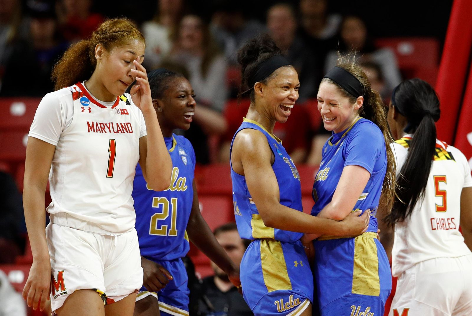 UCLA guard Lindsey Corsaro, second from right, celebrates with teammates Lajahna Drummer, third from right, and Michaela Onyenwere (21), nearMaryland forward Shakira Austin (1), after Corsaro was fouled iduringthe second half of a second-round game in the NCAA women's college basketball tournament Monday, March 25, 2019, in College Park, Md. UCLA won 85-80. (AP Photo/Patrick Semansky)
