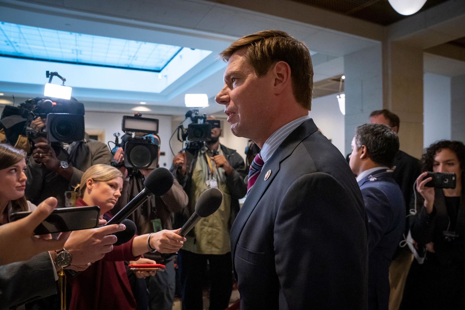 Rep. Eric Swalwell, D-Calif., a member of the House Intelligence Committee, answers questions from reporters about the day-long meeting behind closed-doors with top U.S. diplomat, William Taylor, who is testifying in the Democrats' impeachment investigation of President Donald Trump, in Washington, Tuesday, Oct. 22, 2019. (AP Photo/J. Scott Applewhite)