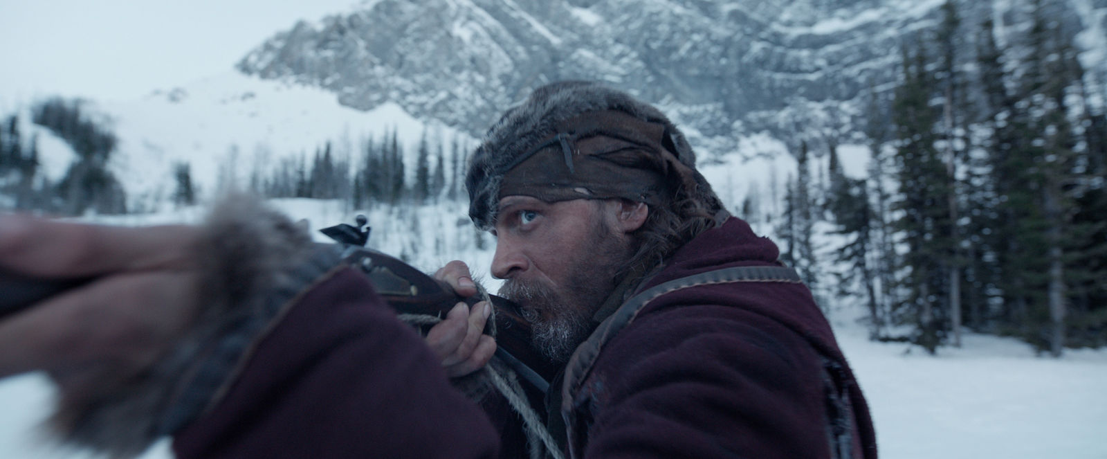 "This photo provided by courtesy of  Twentieth Century Fox shows, Tom Hardy as John Fitzgerald, in a scene from the film, ""The Revenant,"" directed by Alejandro Gonzalez Inarritu. The movie opens in U.S. theaters on Jan. 8, 2016. (Courtesy Twentieth Century Fox via AP)"