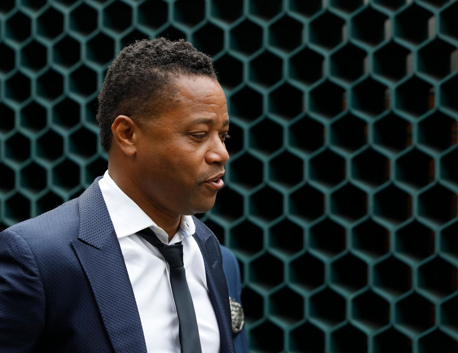 Actor Cuba Gooding Jr., left, is lead by a police officer from New York's Special Victim's Unit, Thursday, June 13, 2019. (AP Photo/Mark Lennihan)