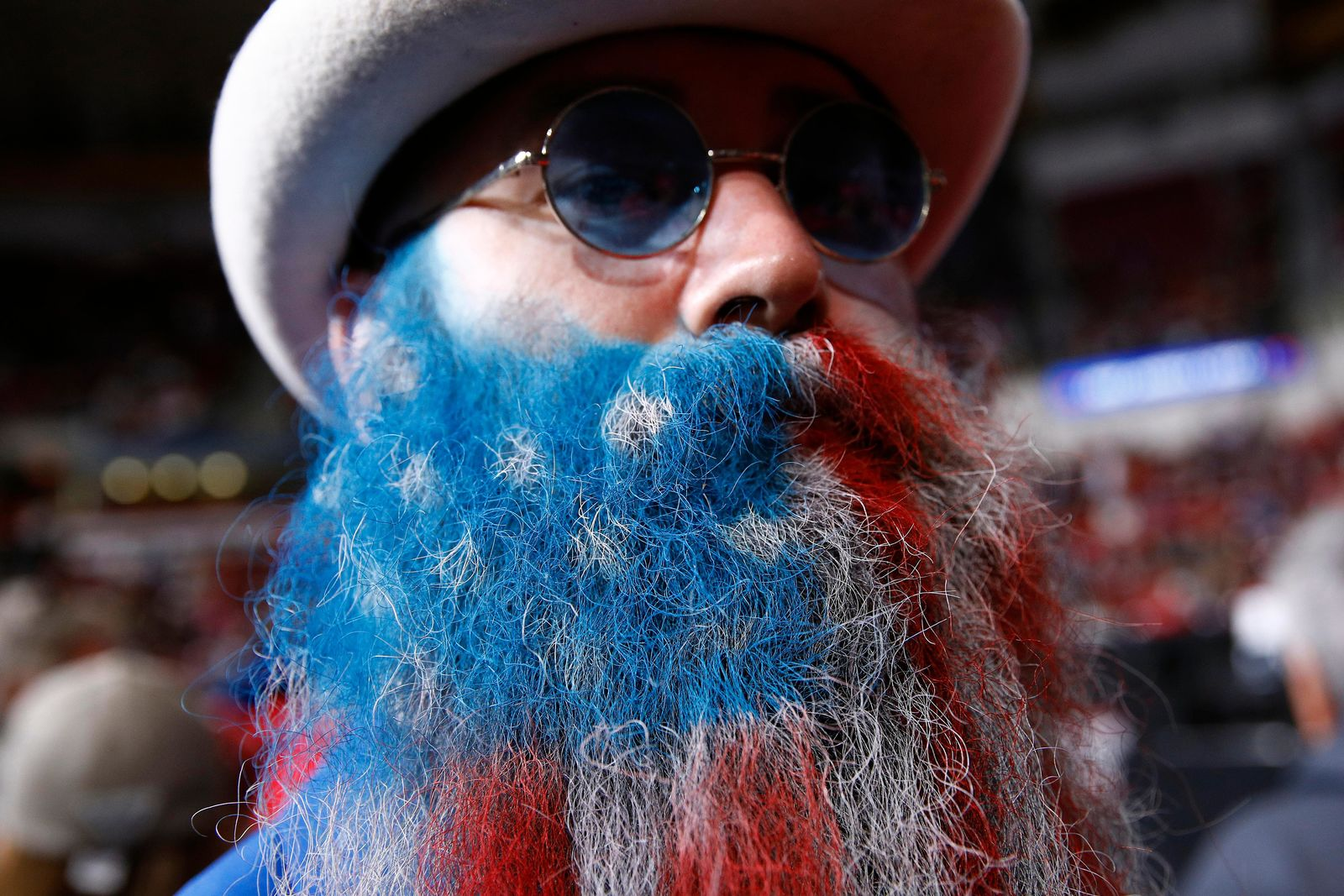 Adam Gazda of Savannah, Ga., shows off his beard painted in the colors of the American flag before a campaign rally for President Donald Trump, Friday, Feb. 28, 2020, in North Charleston, S.C. (AP Photo/Patrick Semansky)