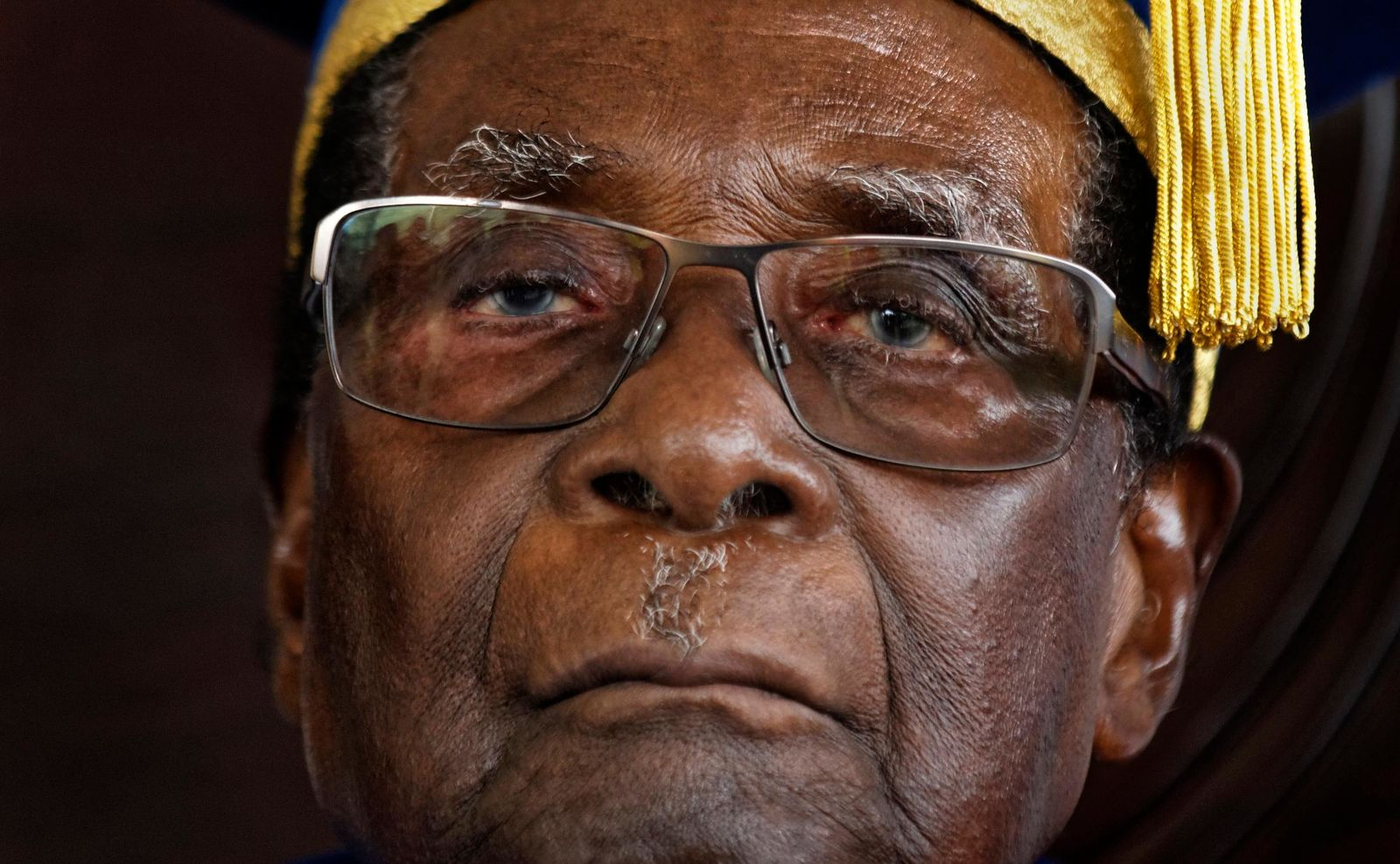 FILE -- In this Friday, Nov. 17, 2017 file photo, Zimbabwe's President Robert Mugabe officiates at a student graduation ceremony at Zimbabwe Open University on the outskirts of Harare, Zimbabwe. On Friday, Sept. 6, 2019, Zimbabwe President Emmerson Mnangagwa said his predecessor Robert Mugabe, age 95, has died.  (AP Photo/Ben Curtis, File)