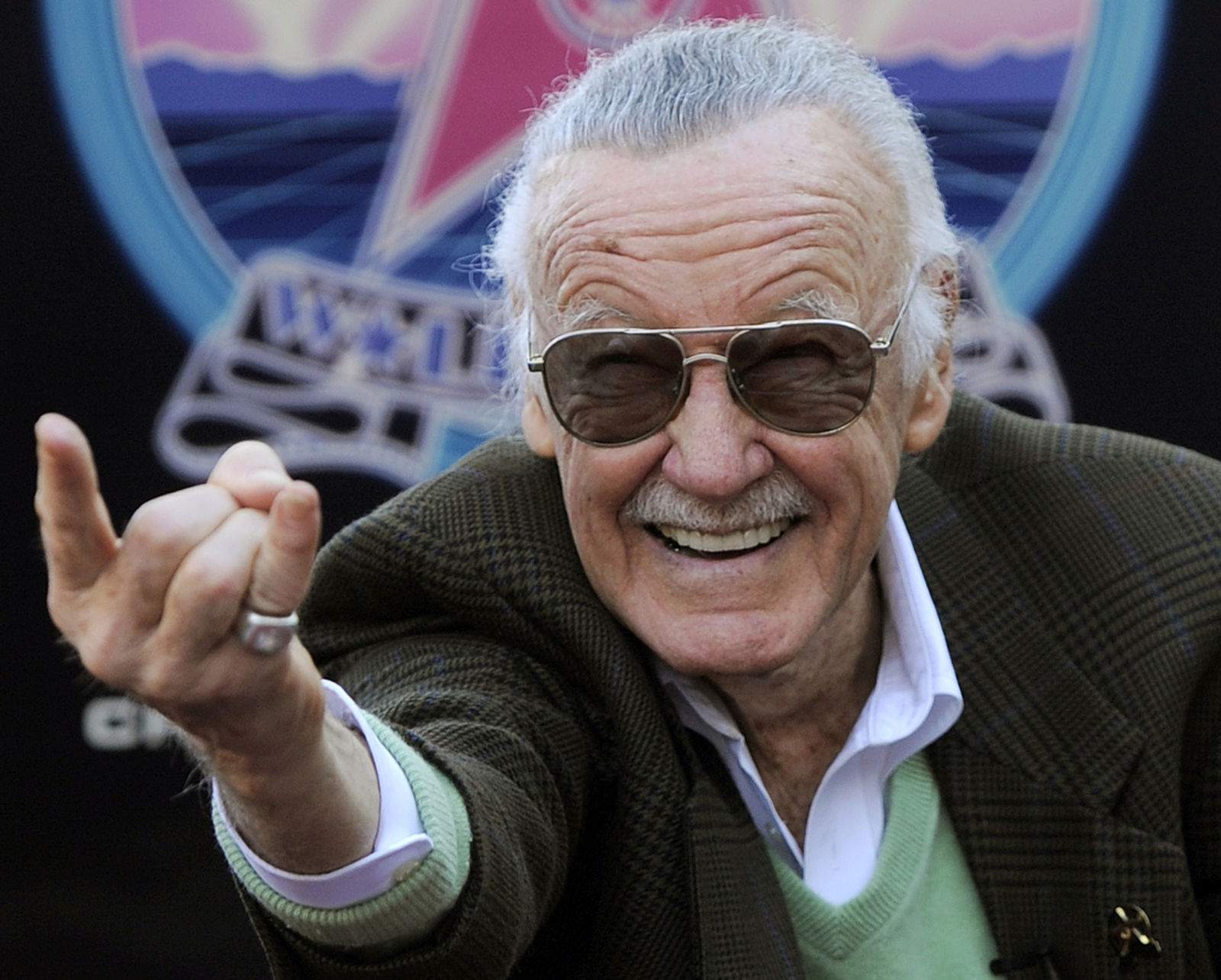 FILE - In this Jan. 4, 2011 file photo, Comic book creator Stan Lee strikes the Spiderman pose as he poses after receiving a star on the Hollywood Walk of Fame in Los Angeles. A former business manager of Stan Lee has been arrested on elder abuse charges involving the late comic book icon. (AP Photo/Chris Pizzello, File)