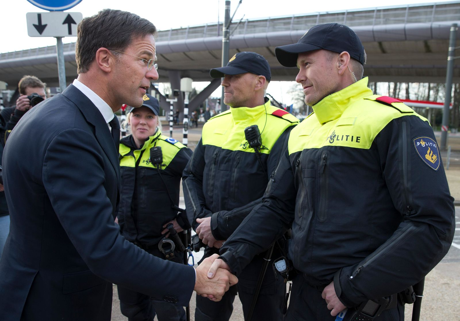 Dutch Prime Minister Mark Rutte expresses his gratitude to Dutch police officers after laying flowers at a makeshift memorial for victims of a shooting incident in a tram in Utrecht, Netherlands, Tuesday, March 19, 2019. A gunman killed three people and wounded others on a tram in the central Dutch city of Utrecht Monday March 18, 2019. (AP Photo/Peter Dejong)