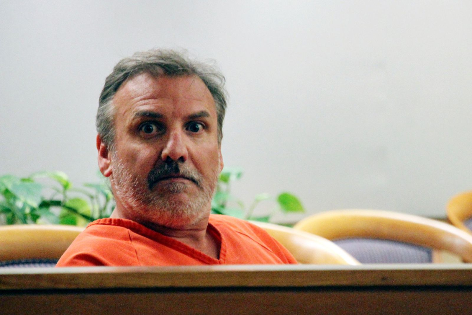 FILE - In this Wednesday, Oct. 16, 2019, file photo, Brian Steven Smith sits in a courtroom while waiting for his arraignment to start in Anchorage, Alaska. Losing a digital memory card that contained photos and videos of a horrendous killing may have been careless, but what led police to charge Smith was something he had no control over whatsoever: His South African accent. (AP Photo/Mark Thiessen, File)