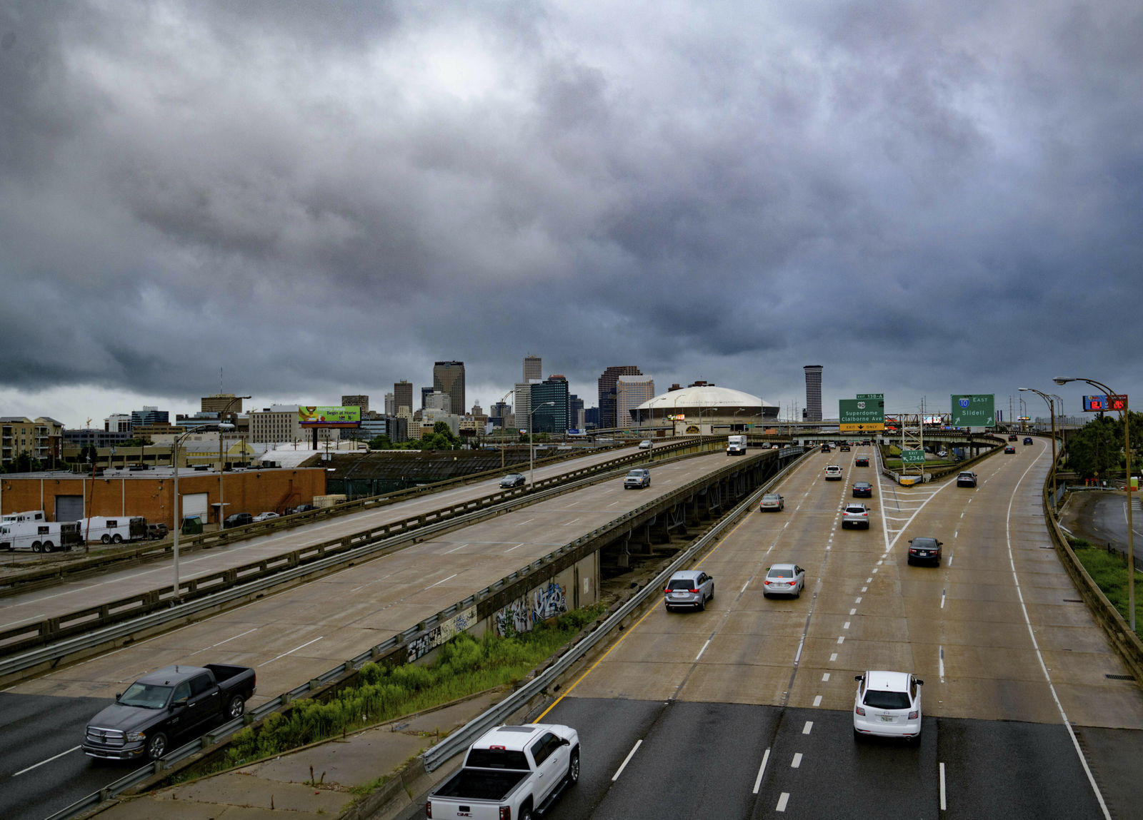Vehicles make their way on I-10 as bands of rain from Tropical Storm Barry from the Gulf of Mexico move into New Orleans, La., Friday, July 12, 2019. (AP Photo/Matthew Hinton)
